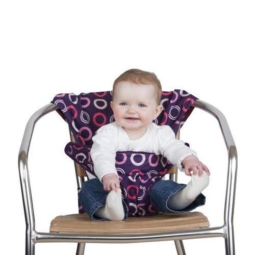 Дорожный детский стульчик Totseat, цвет: ежевика1000100002Дорожный детский стульчик Totseat - незаменимая вещь в дороге или в гостях, если вы решили покормить малыша, а под рукой нет детского стульчика. Это компактный стульчик для кормления, предназначенный для детей от 6 до 30 месяцев, подходит для любого обычного стула со спинкой и легко поместиться в женскую сумочку. Totseat - это отличный подарок и полезный аксессуар в поездке. Вы можете взять его на пикник и посадить кроху отдыхать в шезлонге. А дополнительная упаковочная сумочка на молнии отлично подойдет для мокрого слюнявчика!