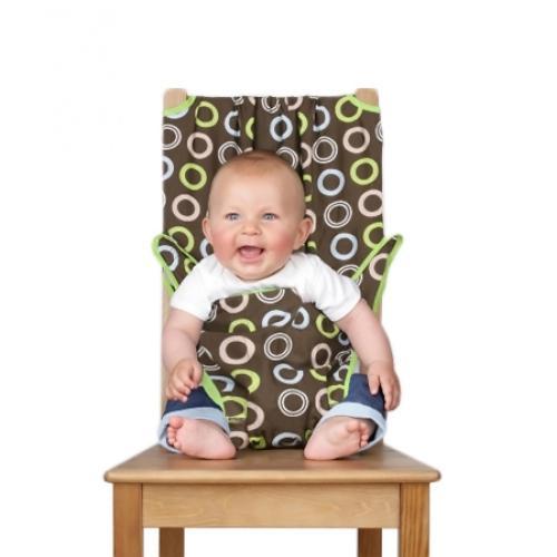 Дорожный детский стульчик Totseat, цвет: шоколад1000100001Дорожный детский стульчик Totseat - незаменимая вещь в дороге или в гостях, если вы решили покормить малыша, а под рукой нет детского стульчика. Это компактный стульчик для кормления, предназначенный для детей от 6 до 30 месяцев, подходит для любого обычного стула со спинкой и легко поместится в женскую сумочку. Totseat - это отличный подарок и полезный аксессуар в поездке. Вы можете взять его на пикник и посадить кроху отдыхать в шезлонге. А дополнительная упаковочная сумочка на молнии отлично подойдет для мокрого слюнявчика!