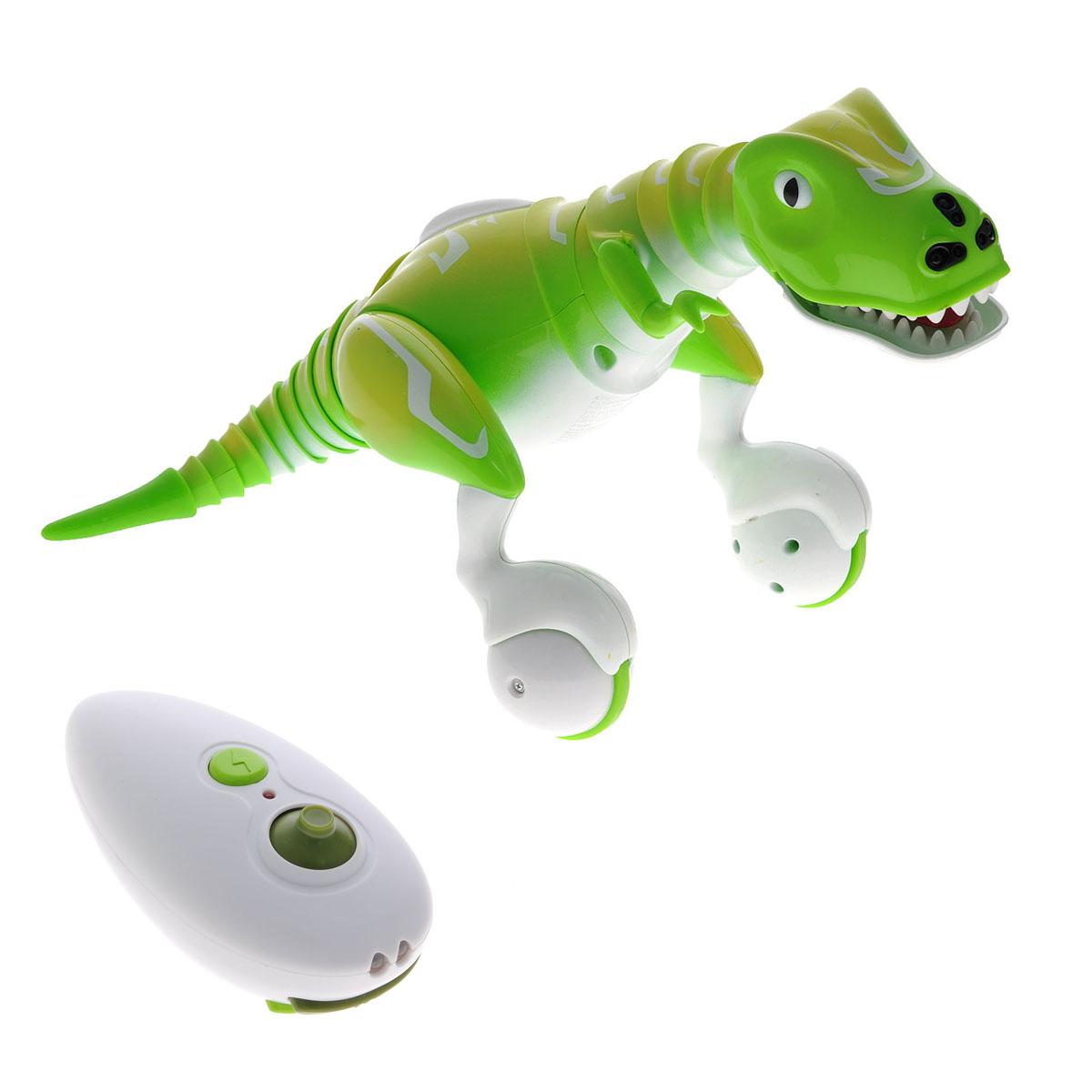 Zoomer Интерактивная игрушка Динозавр14404Интерактивная игрушка Zoomer Динозавр станет чудесным подарком для вашего ребенка! Она выполнена из прочного пластика в виде симпатичного динозаврика по имени Дино. Игрушка работает в 2 режимах. Если вы хотите контролировать ее движения, то воспользуйтесь пультом управления. С его помощью вы сможете управлять динозавром и включать функцию защита, при которой зверь начинает атаковать. В интерактивном режиме игрушка начнет делать произвольные движения, кататься по полу, обнюхивать все вокруг, рычать и урчать. Благодаря шарнирным соединениям динозавр обладает повышенной подвижностью и пластичностью - он может двигать хвостом, головой и шеей. Передвигается игрушка за счет колес, расположенных на задних лапах. Если поднести руку к передней части головы динозавра, он начнет двигаться вслед за ней. Светодиодные, меняющие цвет, глаза подскажут хозяину, в каком сейчас настроении прибывает робот - счастлив он, зол или грустен. Если схватить динозавра за хвост или шею, он вмиг...