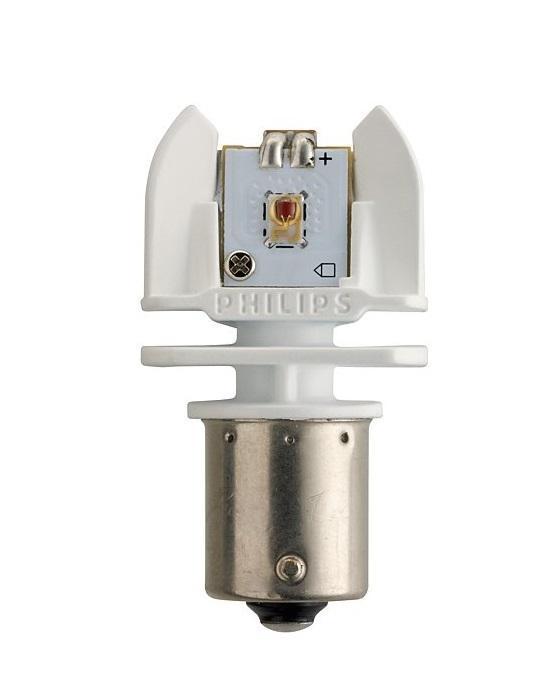 Сигнальная автомобильная лампа Philips P21/5W 12V/24V-21/5W (BAY15d) LED (2шт.) 12899 RX212899 RX2Светодиодные лампы Philips для стоп-сигналов и габаритных огней излучают яркий свет, обеспечивая максимальную видимость и безопасность на дороге благодаря высокой мощности и быстрому отклику. Долговечные и высокопрочные светодиоды будут служить вам 12 лет, избавляя от лишних хлопот. Высокомощные светодиодные лампы для автомобиля Philips излучают яркий красный свет для стильного освещения. Светодиодные стоп-сигналы и габаритные огни Philips включаются быстрее, что обеспечивает транспортному средству, движущемуся сзади, дополнительно 6 метров для торможения (при скорости 120 км/ч).