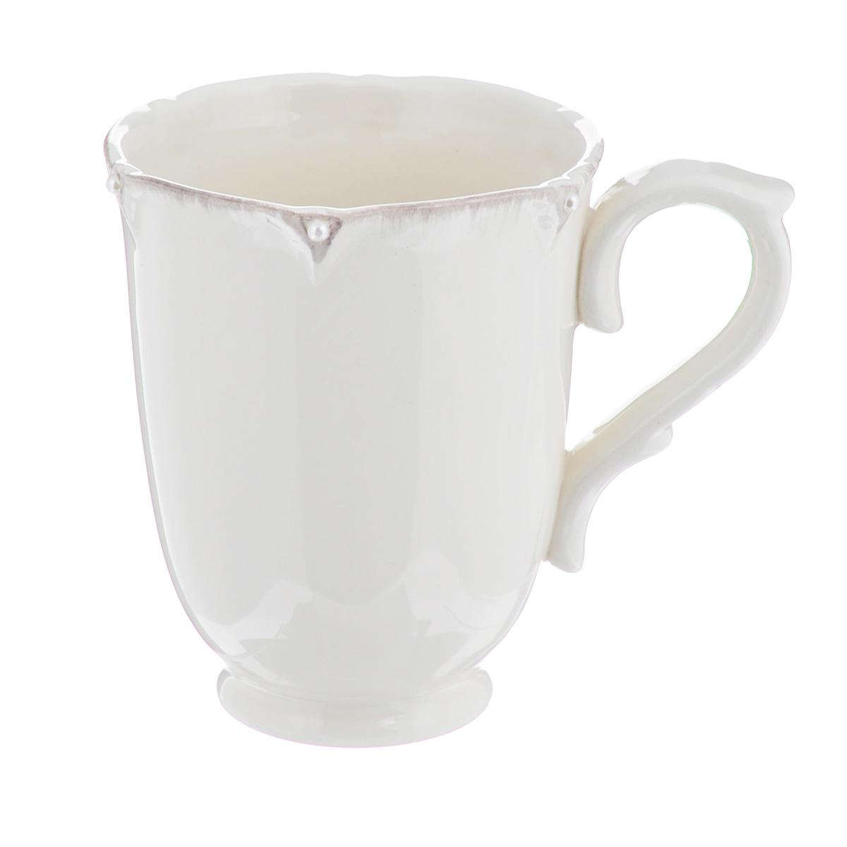 Кружка Lillo Ideal, 350 мл214950Кружка Lillo Ideal выполнена из высококачественной керамики. Края кружки рельефные и декорированы искусственным жемчугом. Такая кружка порадует вас дизайном и функциональностью, а пить чай или кофе из нее станет еще приятнее. Остерегайтесь сильных ударов. Не применять абразивные чистящие средства. Объем: 350 мл. Диаметр кружки по верхнему краю: 9 см. Высота кружки: 11 см.