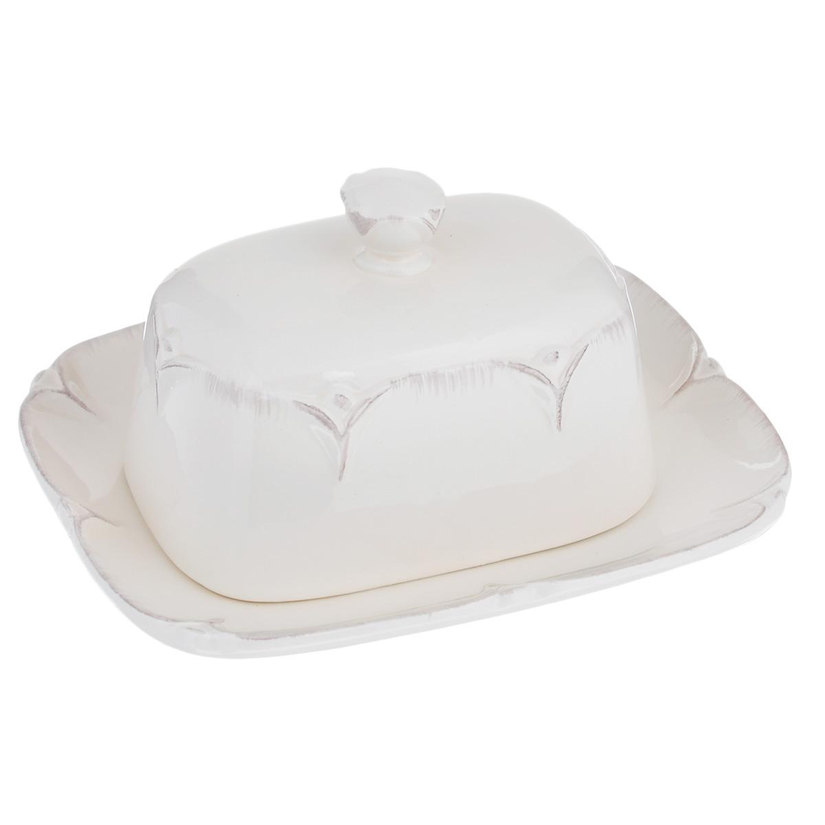 Масленка Lillo Ideal, цвет: молочный214201Масленка Lillo Ideal, изготовленная из керамики, предназначена для красивой сервировки и хранения масла. Она состоит из крышки с удобной ручкой и подноса. Масло в ней долго остается свежим, а при хранении в холодильнике не впитывает посторонние запахи. Гладкая поверхность обеспечивает легкую чистку. Можно мыть в посудомоечной машине.