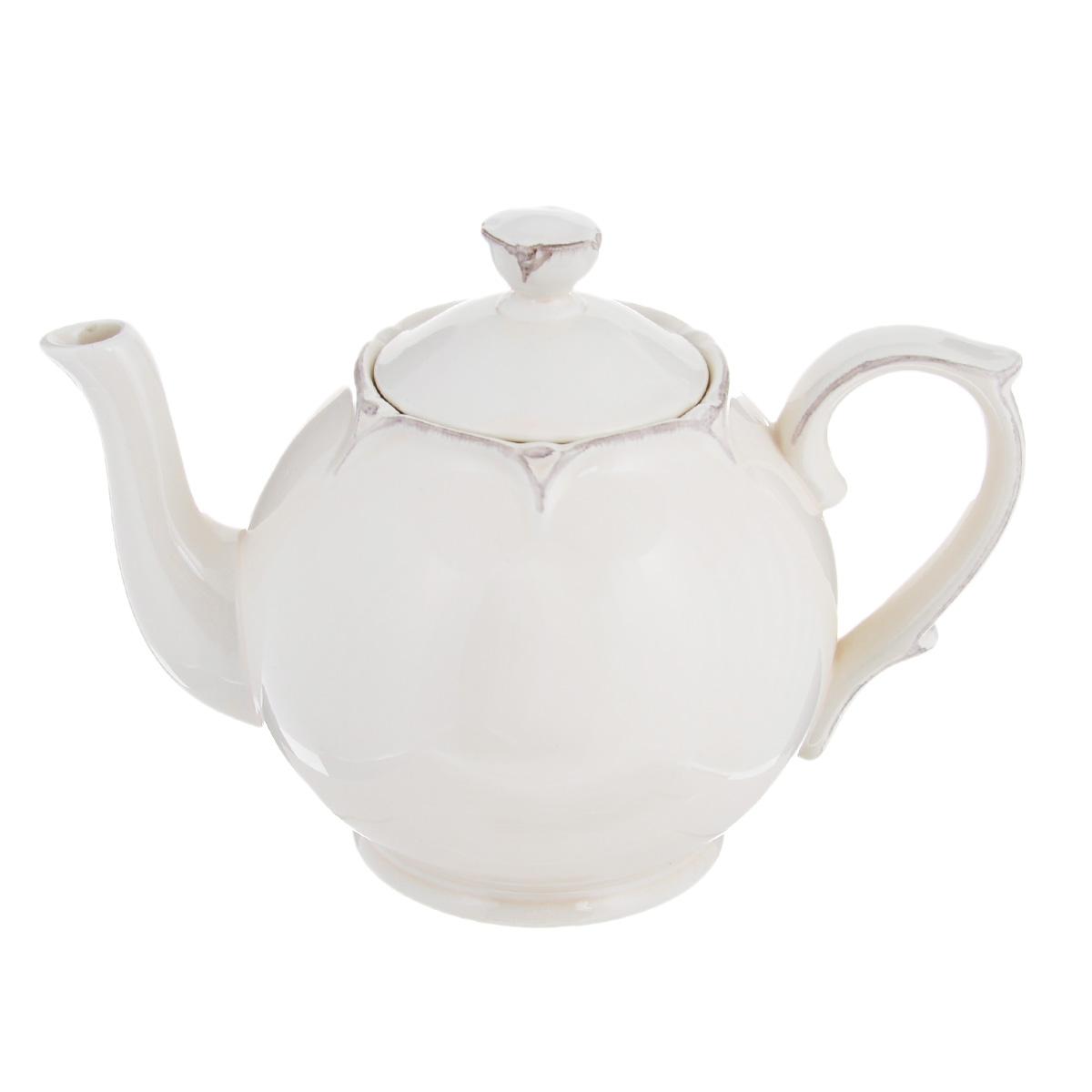 Чайник заварочный Lillo Ideal, цвет: молочный, 1 л214198Чайник заварочный Lillo Ideal изготовлен из высококачественной керамики. Чайник станет отличным дополнением к вашему кухонному инвентарю, а также украсит сервировку стола и подчеркнет прекрасный вкус хозяина. Можно использовать в посудомоечной машине и микроволновой печи. Диаметр чайника (по верхнему краю): 6,5 см. Диаметр основания чайника: 8,5 см. Высота чайника (без учета крышки и ручки): 12,5 см. Объем чайника: 1 л.