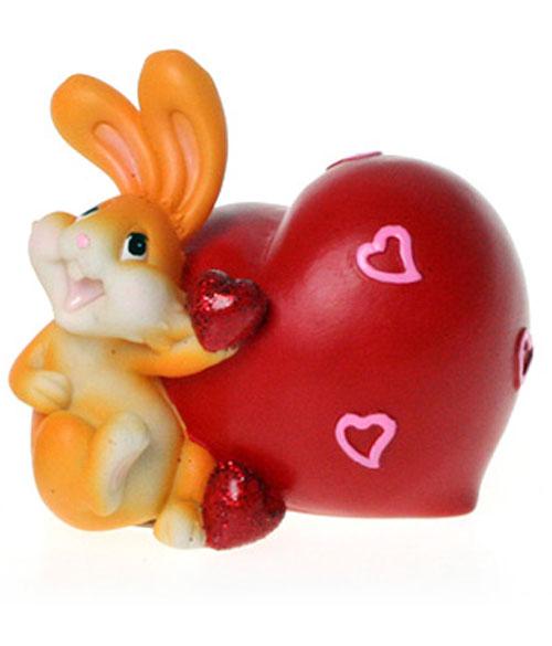 Копилка декоративная Lunten Ranta Нежный кролик57890Декоративная копилка Lunten Ranta Нежный кролик, выполненная из полирезины, станет отличным украшением интерьера вашего дома или офиса. Копилка выполнена в виде забавного кролика с сердечками. Имеется прорезь для монеток на сердечке и отверстие на дне изделия, закрывающееся на резиновую пробку, для извлечения денег. Копилка - это оригинальный и нужный подарок на все случаи жизни. Также она может стать оригинальным подарком для всех любителей стильных вещей.