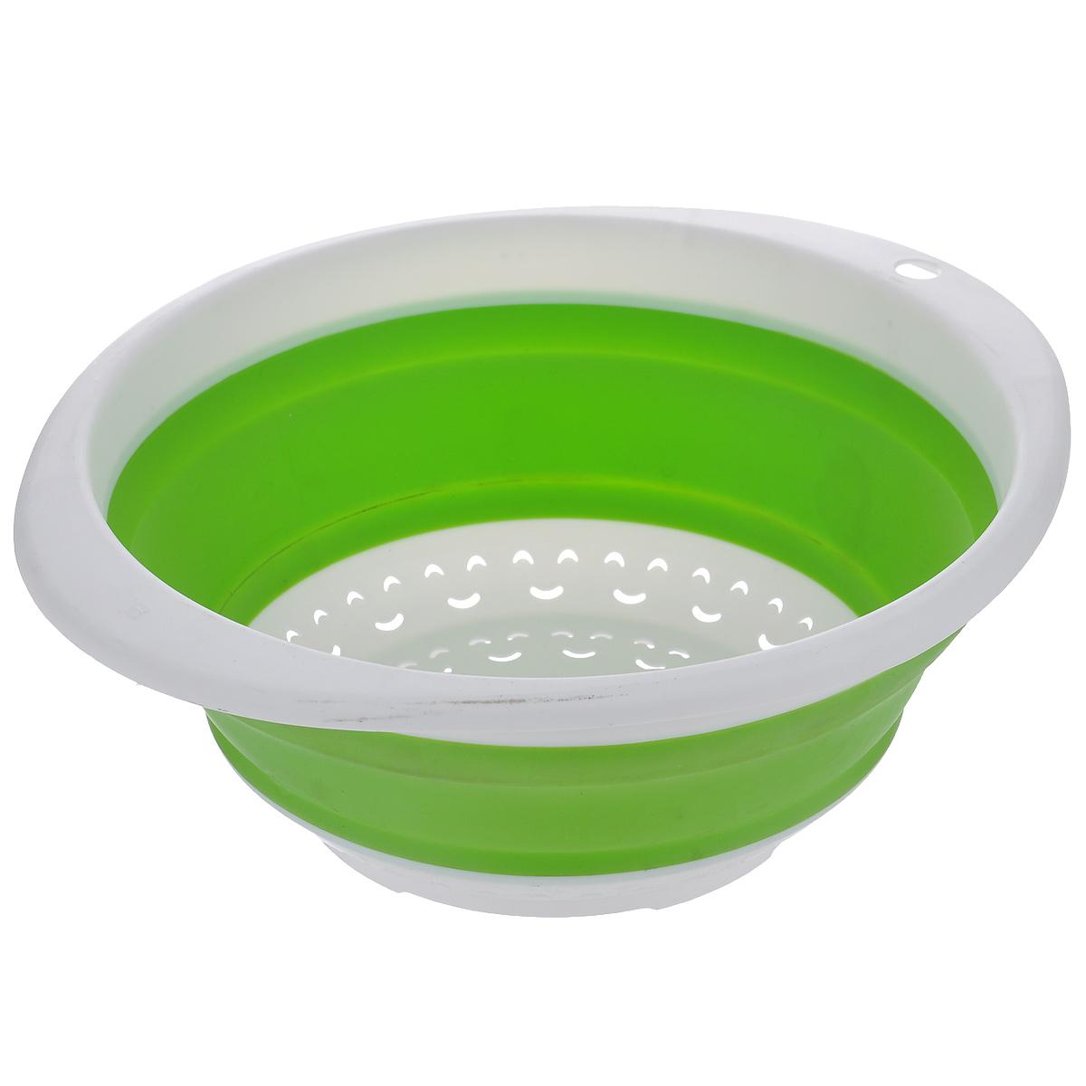 Дуршлаг складной Oriental Way, цвет: белый, салатовый, 30 см х 27 см8865Складной дуршлаг Oriental Way станет полезным приобретением для вашей кухни. Он изготовлен из высококачественного пищевого силикона и пластика. Дуршлаг оснащен двумя удобными ручками. Одна ручка снабжена специальным отверстием для подвешивания. Изделие прекрасно подходит для процеживания, ополаскивания и стекания макарон, овощей, фруктов. Дуршлаг компактно складывается, что делает его удобным для хранения. Можно мыть в посудомоечной машине. Размер (по верхнему краю): 30 см х 27 см. Внутренний диаметр: 24 см. Максимальная высота: 10,5 см. Минимальная высота: 3,5 см.