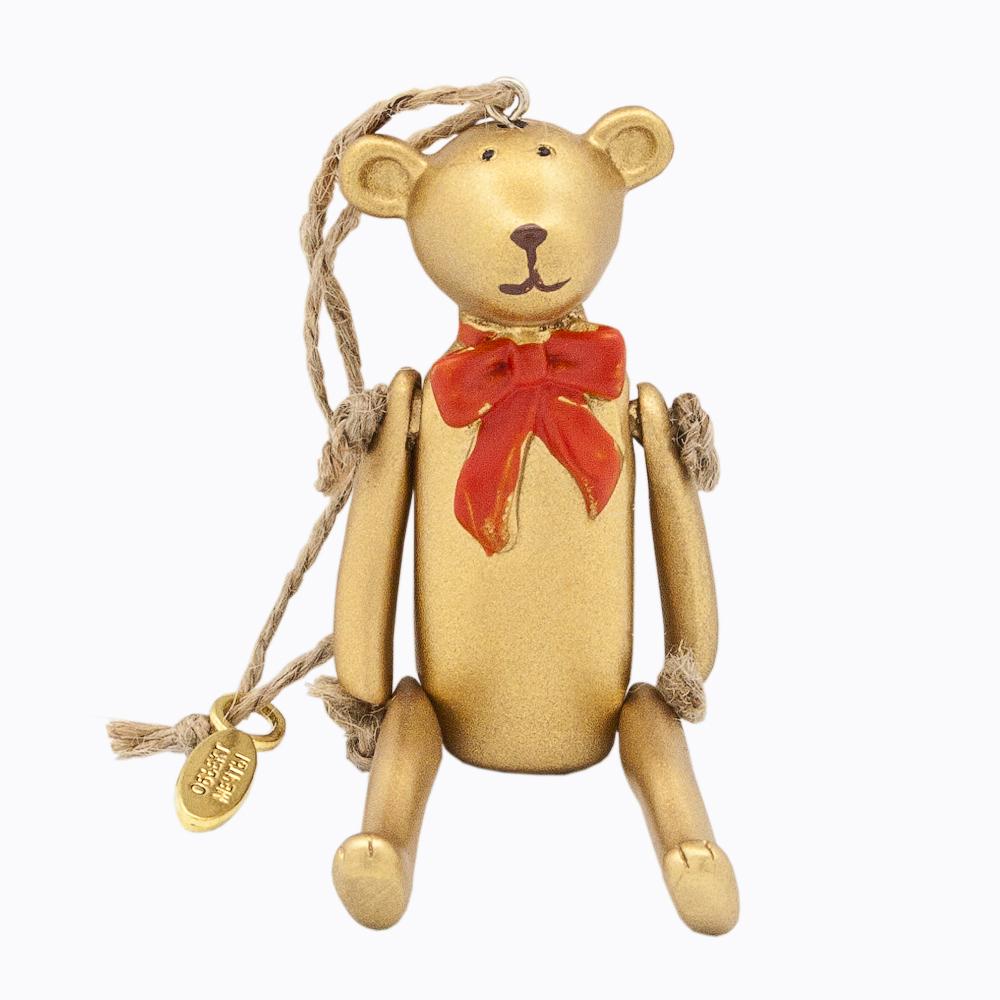 Подвеска декоративная Счастье с праздничным бантом, цвет: золотой83346Подвеска декоративная Счастье с праздничным бантом выполнена из полистоуна в виде мишки. У Мишки подвижные лапы. Он может сидеть, лежать и стоять даже на одной ножке. Подвеска имеет шнурок, за который его можно повесить на ручку двери или окна. Медвежонок претендует стать самым ярким украшением новогодней елки. А во все остальные дни года он способен оживить любой уголок вашей комнаты или салон автомобиля! Размер подвески: 9 см х 3 см х 2 см.