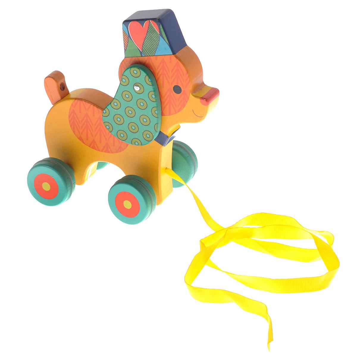 Djeco Деревянная игрушка-каталка Собачка Нэко06232Деревянная игрушка-каталка Djeco Собачка Нэко выполнена из дерева с использованием нетоксичных красок в виде забавной собачки с подвижными ушками. Края игрушки закруглены, чтобы избежать вероятности травмирования. Каталка оснащена четырьмя колесиками. За текстильную ленточку малыш сможет возить игрушку за собой. Яркая игрушка-каталка Djeco Собачка Нэко развивает пространственное мышление, цветовое восприятие, ловкость, равновесие и координацию движений.