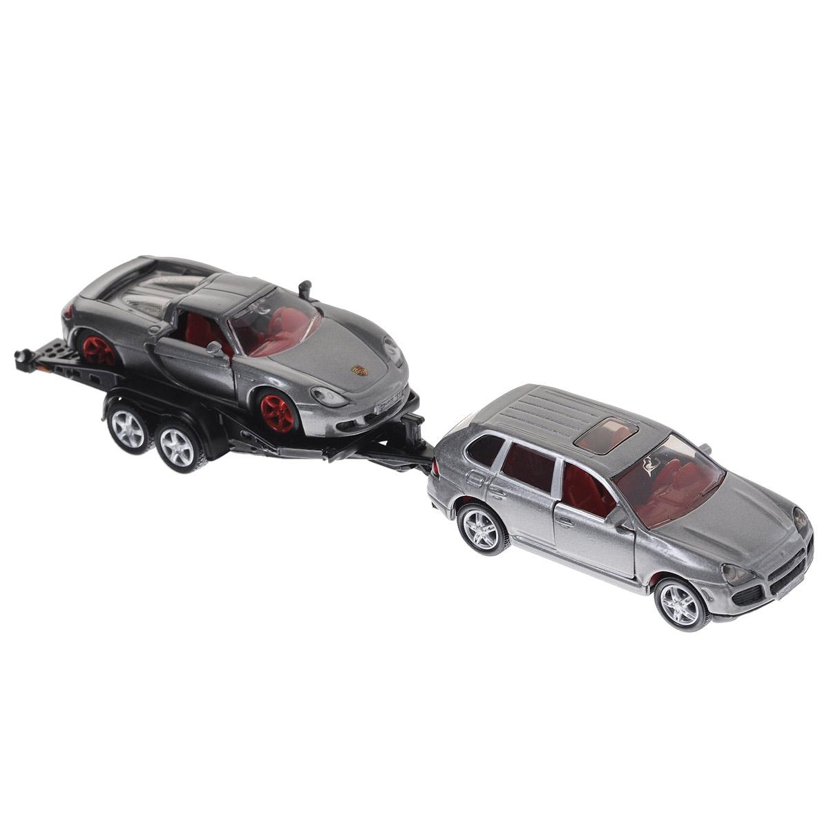 Siku Модель автомобиля Porsche Cayenne Turbo с прицепом и Porsche GT2544Коллекционная модель Siku Машина с прицепом выполнена в виде точной копии автомобиля с прицепом в масштабе 1/55. Такая модель понравится не только ребенку, но и взрослому коллекционеру и приятно удивит вас высочайшим качеством исполнения. В комплект входят 2 машинки и прицеп. Корпус модели выполнен из металла, стекла кабины водителя изготовлены из прочного прозрачного пластика, колесики - из резины. Колесики машинок и прицепа вращаются. Дверцы обоих машинок открываются, прицеп отцепляется, спортивный автомобиль может съезжать с прицепа. Коллекционная модель отличается великолепным качеством исполнения и детальной проработкой, она станет не только интересной игрушкой для ребенка, интересующегося автотехникой, но и займет достойное место в любой коллекции.