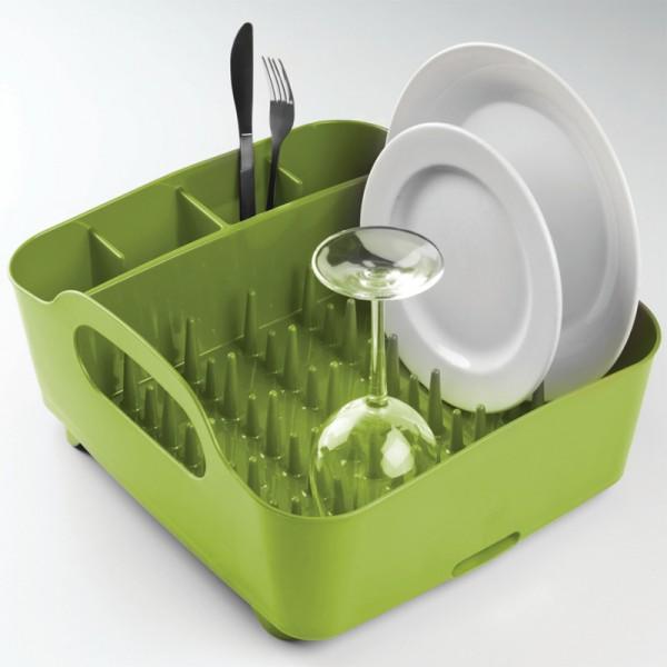 Сушилка для посуды Umbra Tub, цвет: зеленый, 34,5 см х 37 см х 18 см330590-806Сушилка для посуды Umbra Tub выполнена из полипропилена - высокопрочного нескользящего материала. Компактный дизайн изделия создает огромное пространство для хранения и сушки посуды. Несколько отсеков, которые позволяют уместить приборы, чашки, тарелки, и при этом они все будут на своем месте. В ней даже можно сушить бокалы и стаканы, благодаря специальным шипам, они не будут скользить. Сушилка ставится прямо в раковину. Благодаря ножкам, вода не будет застаиваться под сушилкой. Для удобства переноски изделие имеет удобные ручки. Размер сушилки: 34,5 см х 37 см х 18 см.