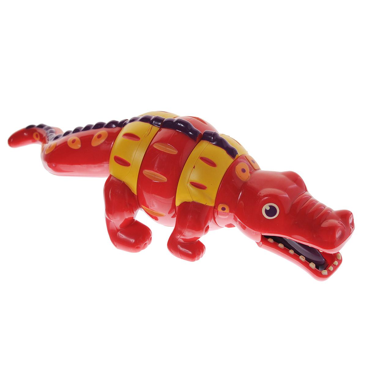 Battat Погремушка-трещотка Крокодил68665Яркая погремушка-трещотка Крокодил, непременно, понравится вашему малышу. Оказывается, крокодил совсем не страшный зверь! Очаровательный разноцветный крокодильчик станет лучшим другом вашего малыша - наверняка он сразу же примется изучать необычную игрушку и порадуется, услышав забавные звуки трещотки. Тело крокодила состоит трех шарнирных частей, которые можно вращать по окружности. При этом раздается потрескивающий звук. Пасть крокодила выступает в роли трещотки. Погремушка-трещотка способствует развитию тактильных ощущений, мелкой моторики рук малыша, формирует цветовое и звуковое восприятие.