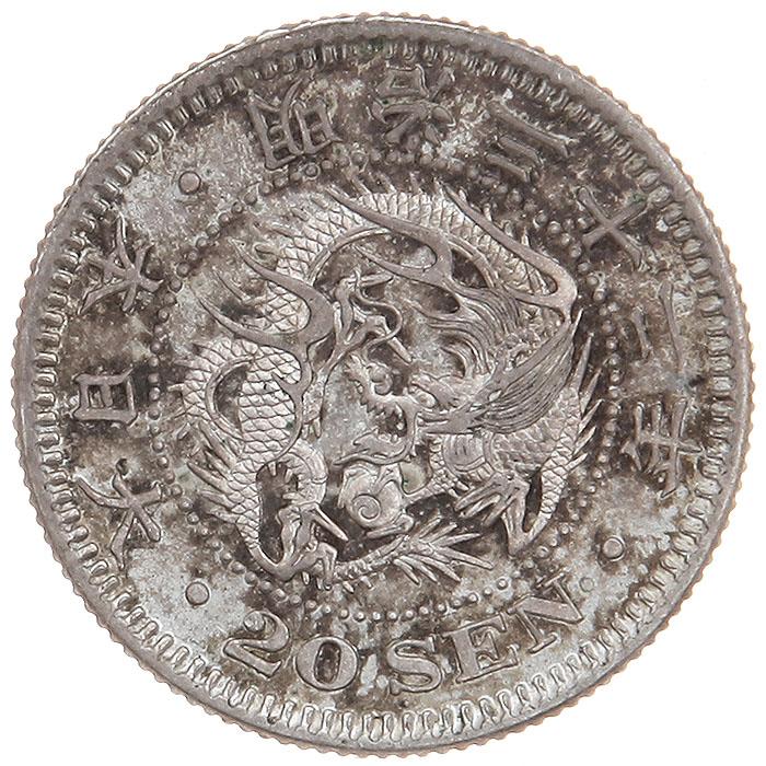 Монета номиналом 20 сен. Биллон. Япония, 1899 годK421306Монета номиналом 20 сен. Биллон. Япония, 1899 год. Император Муцухито (1867-1912), (девиз правления - мэйдзи). Диаметр: 2.2 см. Гурт рифленый. Сохранность хорошая. Старинная японская монета эпохи Мэйдзи займет достойное место в Вашей коллекции!