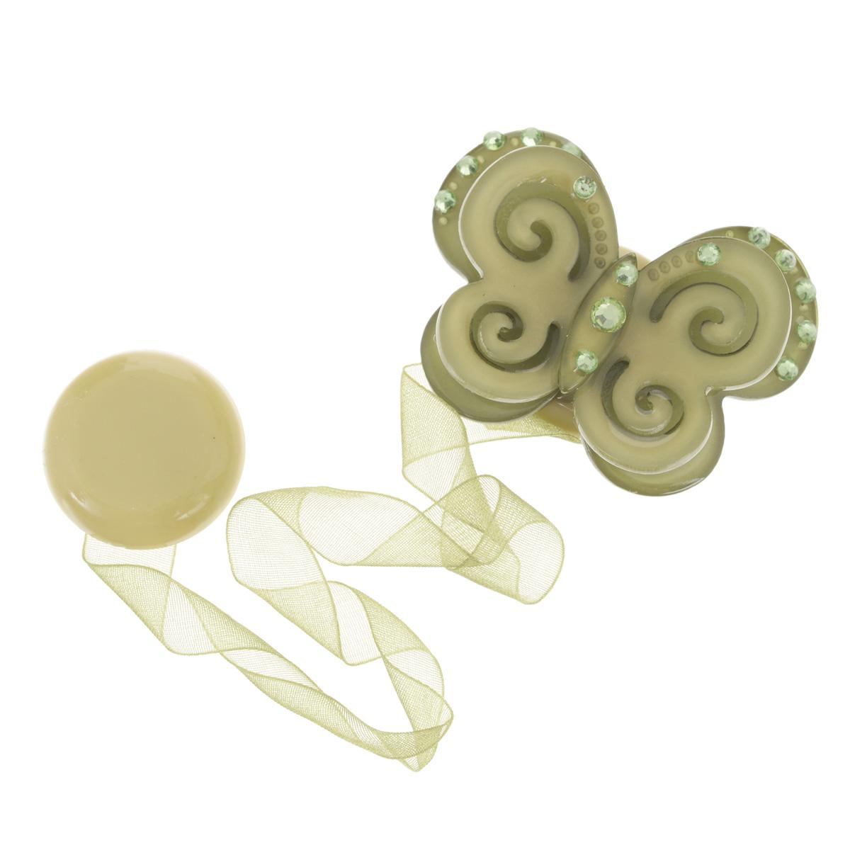 Клипса-магнит для штор Calamita Fiore, цвет: зеленый_7817704010_781Клипса-магнит Calamita Fiore, изготовленная из пластика и текстиля, предназначена для придания формы шторам. Изделие представляет собой два магнита, расположенные на разных концах текстильной ленты. Один из магнитов оформлен декоративной бабочкой со стразами. С помощью такой магнитной клипсы можно зафиксировать портьеры, придать им требуемое положение, сделать складки симметричными или приблизить портьеры, скрепить их. Клипсы для штор являются универсальным изделием, которое превосходно подойдет как для штор в детской комнате, так и для штор в гостиной. Следует отметить, что клипсы для штор выполняют не только практическую функцию, но также являются одной из основных деталей декора этого изделия, которая придает шторам восхитительный, стильный внешний вид.