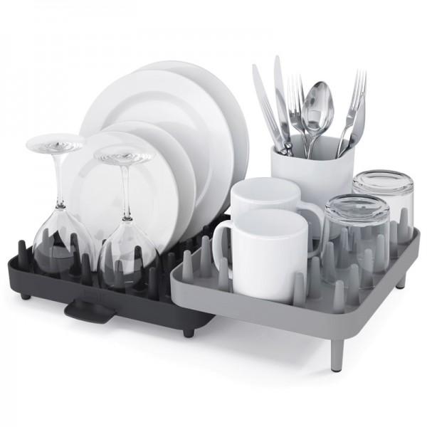Сушилка для посуды Joseph Joseph Connect, цвет: серый, 44,5 х 10,5 х 29 см85035Сушилка для посуды Joseph Joseph Connect изготовлена из высококачественного пластика. Уникальная сушилка, состоящая из трех отделений, поместится на любой кухне, так как ее компоненты можно перемещать друг относительно друга, адаптируя под заданное пространство. Благодаря специальным зубцам можно размещать на ней тарелки, чашки, миски в любой комбинации. Также в комплекте идет специальная подставка для столовых приборов. Стекающая с посуды вода отводится благодаря специальному носику, просто разместите сушилку рядом с раковиной. Благодаря нескользящему основанию сушилка займет свое место на кухне и станет отличным помощником как после обеда на двоих, так и после семейного торжества.