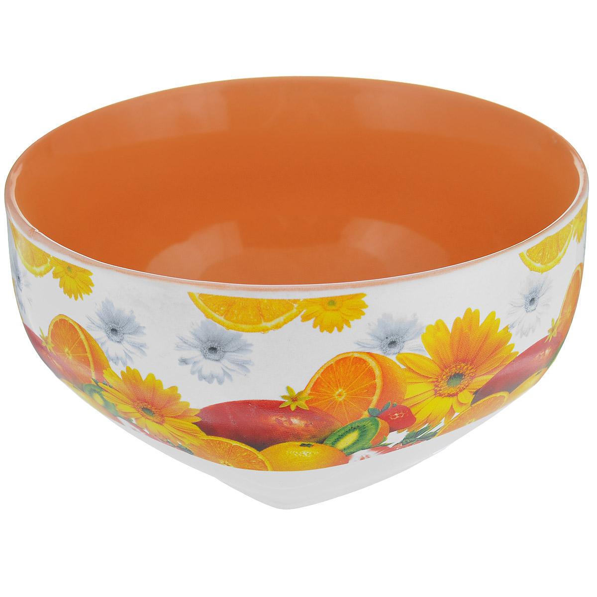 Салатник Цитрус, 510 млSXT M15-1Салатник Цитрус изготовлен из высококачественной керамики и декорирован ярким изображением цветов и апельсинов. Он прекрасно впишется в интерьер вашей кухни и станет достойным дополнением к кухонному инвентарю. Такой салатник не только украсит ваш кухонный стол и подчеркнет прекрасный вкус хозяйки, но и станет отличным подарком. Можно использовать в посудомоечной машине и микроволновой печи.
