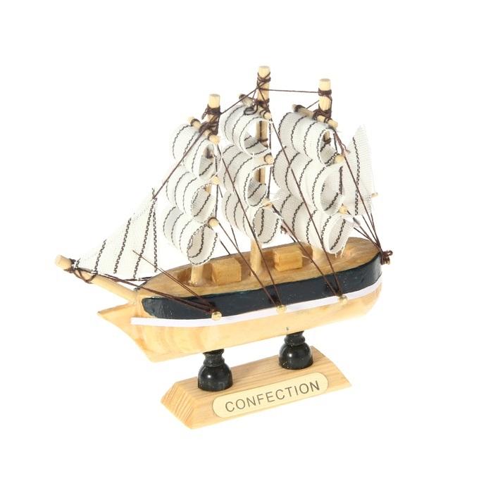 Корабль сувенирный Confection, длина 10 см. 805882805882Сувенирный корабль Confection, изготовленный из дерева и текстиля, это великолепный элемент декора рабочей зоны в офисе или кабинете. Корабль с парусами помещен на деревянную подставку. Время идет, и мы становимся свидетелями развития технического прогресса, новых учений и практик. Но одно не подвластно времени - это любовь человека к морю и кораблям. Сувенирный корабль наполнен историей и силой океанских вод. Данная модель кораблика станет отличным подарком для всех любителей морей, поклонников историй о покорении океанов и неизведанных земель. Модель корабля - подарок со смыслом. Издавна на Руси считалось, что корабли приносят удачу и везение. Поэтому их изображения, фигурки и точные копии всегда присутствовали в помещениях. Удивите себя и своих близких необычным презентом.