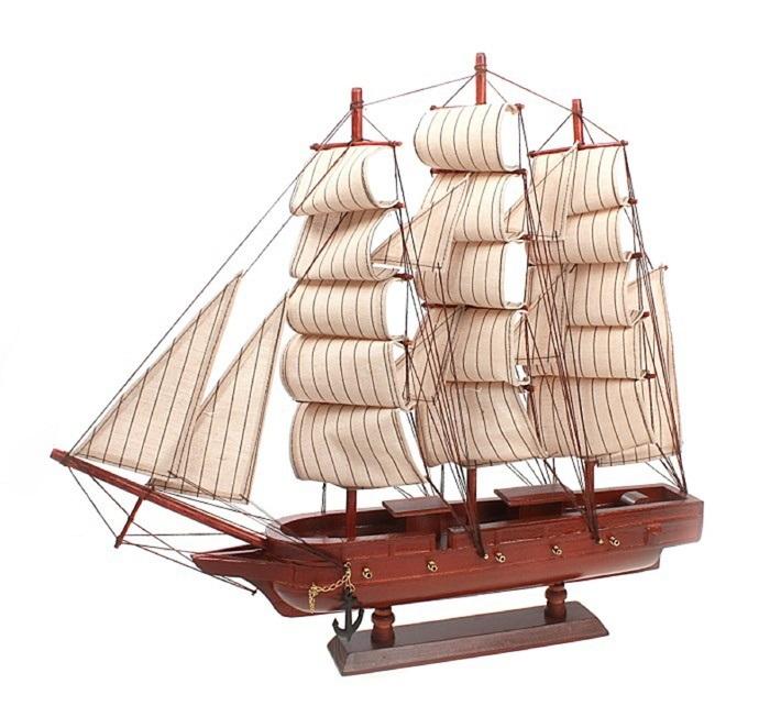 Корабль сувенирный Корабль удачи, длина 45 см. 404854404854Сувенирный корабль Корабль удачи, изготовленный из дерева и текстиля, это великолепный элемент декора рабочей зоны в офисе или кабинете. Корабль с парусами и якорями помещен на деревянную подставку. Время идет, и мы становимся свидетелями развития технического прогресса, новых учений и практик. Но одно не подвластно времени - это любовь человека к морю и кораблям. Сувенирный корабль наполнен историей и силой океанских вод. Данная модель кораблика станет отличным подарком для всех любителей морей, поклонников историй о покорении океанов и неизведанных земель. Модель корабля - подарок со смыслом. Издавна на Руси считалось, что корабли приносят удачу и везение. Поэтому их изображения, фигурки и точные копии всегда присутствовали в помещениях. Удивите себя и своих близких необычным презентом.