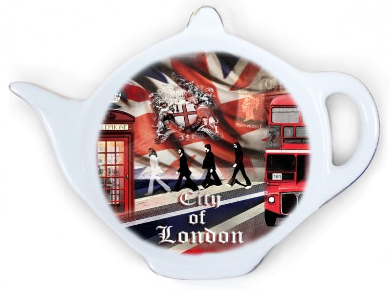 Подставка для чайных пакетиков GiftnHome Лондонские фантазииTB-LondonПодставка для чайных пакетиков GiftnHome Лондонские фантазии, изготовленная из фарфора, порадует вас оригинальностью и дизайном. Подставка выполнена в форме чайничка и декорирована ярким цветным изображением улицы Лондона. Подставка, несомненно, понравится любой хозяйке, а кухонный стол всегда будет чистым, без нежелательных разводов от чайных пакетиков. Размер подставки: 11,5 см х 8,5 см х 2 см.