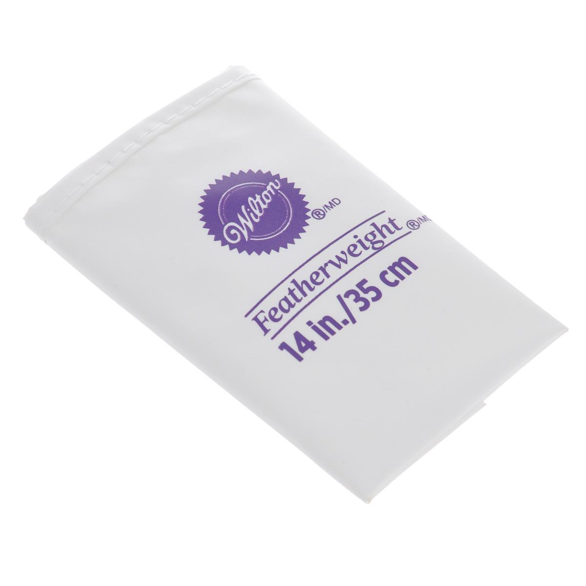 Кондитерский мешок Wilton, многоразовый, цвет: белый, 35 смWLT-404-5140Высококачественный кондитерский мешок Wilton, выполненный из полиэстера, предназначен для декорирования выпечки. Если вы любите побаловать своих домашних вкусной и ароматной выпечкой по вашему оригинальному рецепту, украшенной воздушным кремом, то кондитерский мягкий, гибкий и прочный мешок Wilton как раз то, что вам нужно! С его помощью вы создадите необыкновенные украшения на торте, наполните трубочки кремом и многое другое. Можно мыть в посудомоечной машине. Высота мешка: 35 см. Ширина мешка: 21 см.