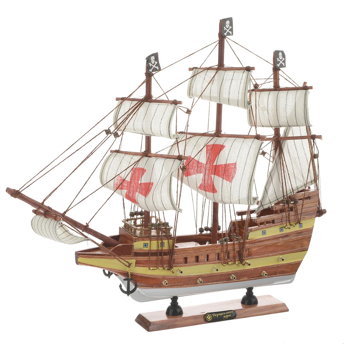 Корабль сувенирный Держись своего курса, длина 40 см417218Сувенирный корабль Держись своего курса, изготовленный из дерева и текстиля, это великолепный элемент декора рабочей зоны в офисе или кабинете. Корабль с парусами и якорями помещен на деревянную подставку. Время идет, и мы становимся свидетелями развития технического прогресса, новых учений и практик. Но одно не подвластно времени - это любовь человека к морю и кораблям. Сувенирный корабль наполнен историей и силой океанских вод. Данная модель кораблика станет отличным подарком для всех любителей морей, поклонников историй о покорении океанов и неизведанных земель. Модель корабля - подарок со смыслом. Издавна на Руси считалось, что корабли приносят удачу и везение. Поэтому их изображения, фигурки и точные копии всегда присутствовали в помещениях. Удивите себя и своих близких необычным презентом.