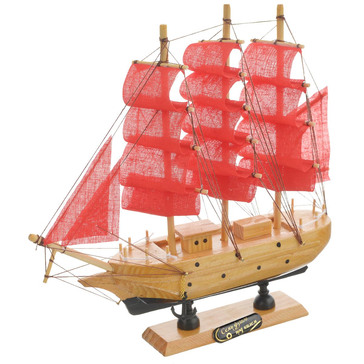 Корабль сувенирный Семь футов под килем, длина 23 см. 432007432007Сувенирный корабль Семь футов под килем, изготовленный из дерева и текстиля, это великолепный элемент декора рабочей зоны в офисе или кабинете. Корабль с парусами и якорями помещен на деревянную подставку. Время идет, и мы становимся свидетелями развития технического прогресса, новых учений и практик. Но одно не подвластно времени - это любовь человека к морю и кораблям. Сувенирный корабль наполнен историей и силой океанских вод. Данная модель кораблика станет отличным подарком для всех любителей морей, поклонников историй о покорении океанов и неизведанных земель. Модель корабля - подарок со смыслом. Издавна на Руси считалось, что корабли приносят удачу и везение. Поэтому их изображения, фигурки и точные копии всегда присутствовали в помещениях. Удивите себя и своих близких необычным презентом.