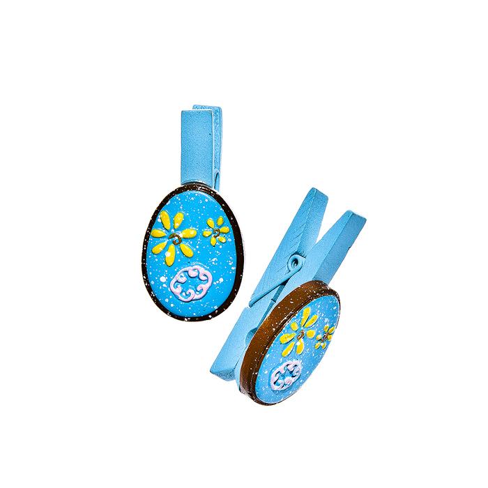 Набор декоративных прищепок Home Queen Весенние цветы, цвет: голубой, 6 шт64468Набор Home Queen Весенние цветы состоит из шести декоративных прищепок. Прищепки выполнены из высококачественного дерева и декорированы фигурками яиц, выполненных из полирезины и украшенных рельефом. Изделия используются для развешивания стикеров на веревке, маленьких игрушек, а оригинальность и веселые цвета прищепок будут радовать глаз и поднимут настроение. Длина прищепки: 4,5 см. Размер фигурки: 3 см х 0,5 см х 2,2 см.