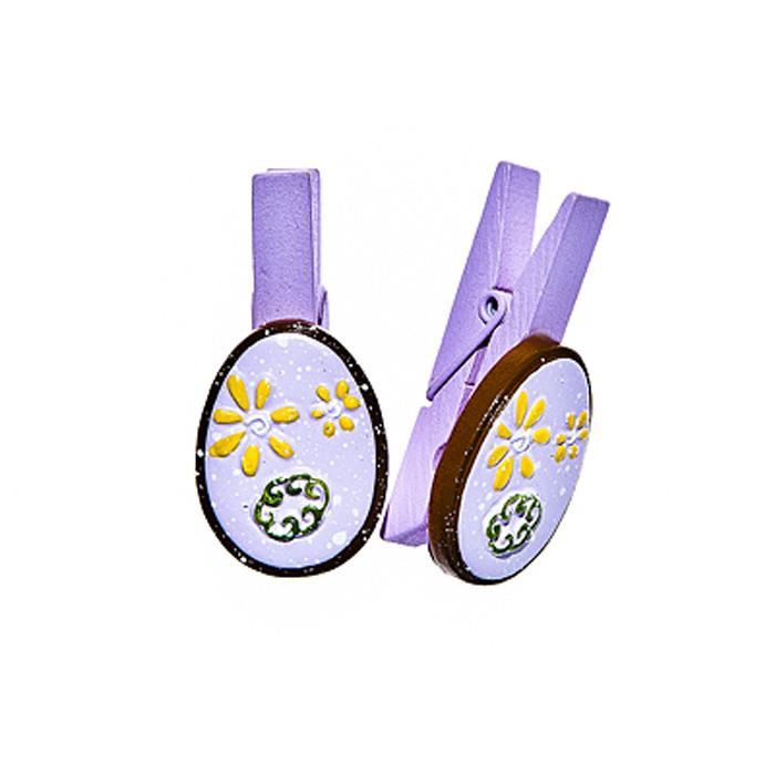 Набор декоративных прищепок Home Queen Весенние цветы, цвет: фиолетовый, 6 шт64469Набор Home Queen Весенние цветы состоит из шести декоративных прищепок. Прищепки выполнены из высококачественного дерева и декорированы фигурками яиц, выполненных из полирезины и украшенных рельефом. Изделия используются для развешивания стикеров на веревке, маленьких игрушек, а оригинальность и веселые цвета прищепок будут радовать глаз и поднимут настроение. Длина прищепки: 4,5 см. Размер фигурки: 3 см х 0,5 см х 2,2 см.