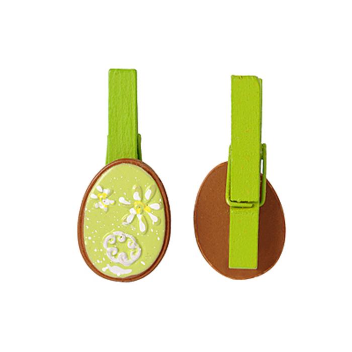 Набор декоративных прищепок Home Queen Весенние цветы, цвет: зеленый, 6 шт64470Набор Home Queen Весенние цветы состоит из шести декоративных прищепок. Прищепки выполнены из высококачественного дерева и декорированы фигурками яиц, выполненных из полирезины и украшенных рельефом. Изделия используются для развешивания стикеров на веревке, маленьких игрушек, а оригинальность и веселые цвета прищепок будут радовать глаз и поднимут настроение. Длина прищепки: 4,5 см. Размер фигурки: 3 см х 0,5 см х 2,2 см.