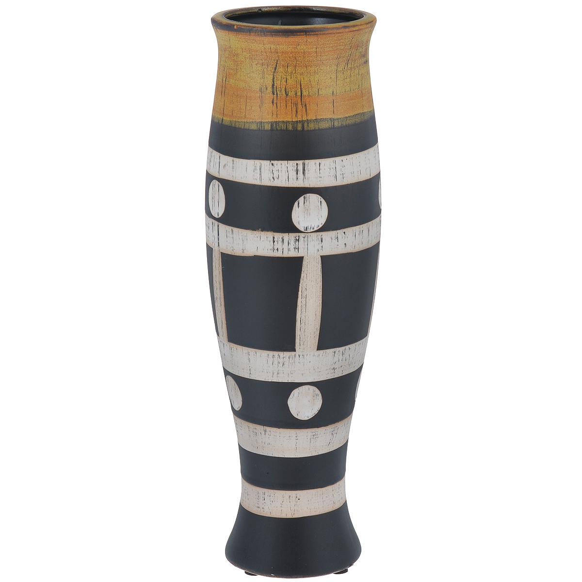 Ваза декоративная Этническая высокая, высота 30,5 см37417Элегантная ваза Этническая высокая выполнена из высококачественного глазурованного фаянса и украшена оригинальным рисунком. Изделие оснащено резиновыми ножками, предотвращающими скольжение вазы по поверхности. Оригинальная ваза Этническая высокая придется по вкусу и ценителям классики, и тем, кто предпочитает утонченность и изящность. Вы можете поставить вазу в любом месте, где она будет удачно смотреться и радовать глаз. Такая ваза подойдет и для цветов, и для декора интерьера. Кроме того - это отличный вариант подарка для ваших близких и друзей. Диаметр вазы (по верхнему краю): 9 см. Высота вазы: 30,5 см.