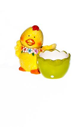 Подставка под яйцо Home Queen Цыпленок с цветочками, цвет: зеленый64256_3Подставка Home Queen Цыпленок с цветочками станет оригинальным украшением праздничного стола на Пасху. Изделие изготовлено из высококачественной керамики. Подставка выполнена в виде забавного цыпленка с ячейкой под яйцо. Такая подставка станет красивым пасхальным подарком для друзей или близких. Размер подставки: 9 см х 5,5 см х 7,5 см.