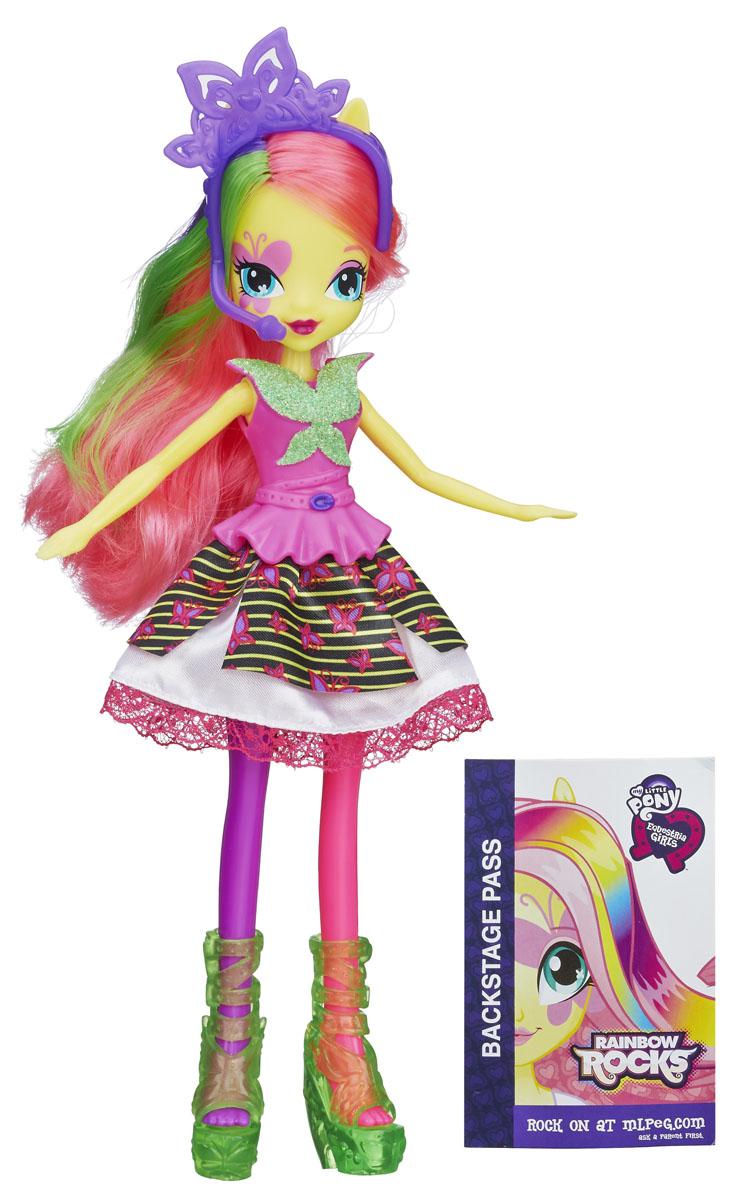 My Little Pony Кукла Rainbow Rocks Флаттершай цвет платья розовыйB0459_A3994_SolidКуклы пони-девочки из мультфильма Equestria Girl (Девочки из Эквестрии) - это удивительные и очаровательные куклы, которых так давно ждали ценители маленьких пони. Кукла My Little Pony Rainbow Rocks: Флаттершай в точности повторяет внешний вид героини из мультфильма. Кукла выполнена в виде девочки-пони Флаттершай. Ее эффектный образ создан специально для выступления на рок-концерте. Длинные розовые волосы Флаттершай украшены зелеными и фиолетовыми прядками. Куколка одета в розовое платье с пышной юбкой, на ногах у нее - прозрачные зеленые сапожки, а голова украшена тиарой с микрофоном и наушниками. Голова, руки и ноги Флаттершай подвижны, благодаря чему ей можно придавать различные позы. Игры с куклой способствуют эмоциональному развитию ребенка, а также помогают формировать воображение и художественный вкус. Малышка проведет множество счастливых часов, играя с очаровательной куколкой. Великолепное качество исполнения делают эту игрушку чудесным подарком к...