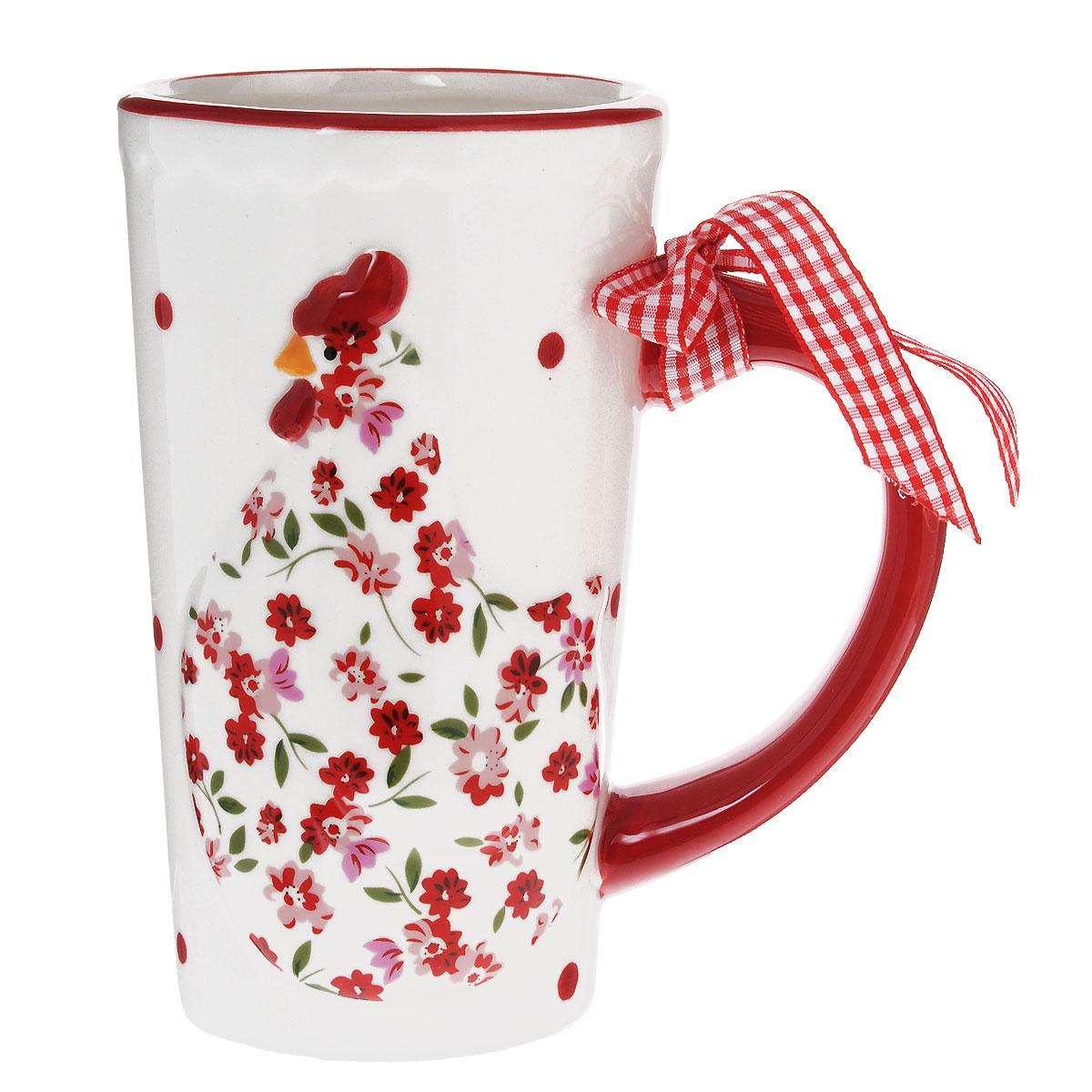 Кружка Lillo Курочка, 600 мл132316Кружка Lillo Курочка выполнена из высококачественной керамики и украшена рельефом в виде милой курочки и текстильным бантом на ручке. Такая кружка порадует вас дизайном и функциональностью, а пить чай или кофе из нее станет еще приятнее. Остерегайтесь сильных ударов. Не применять абразивные чистящие средства. Объем: 600 мл. Диаметр кружки по верхнему краю: 8,5 см. Высота кружки: 15 см.