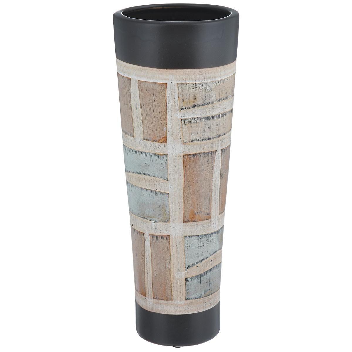 Ваза декоративная Геометрический орнамент, высота 29,5 см37410Элегантная ваза Геометрический орнамент, выполненная из высококачественного глазурованного фаянса, геометрическим орнаментом. Изделие оснащено резиновыми ножками, предотвращающими скольжение вазы по поверхности. Оригинальный дизайн вазы Геометрический орнамент придется по вкусу и ценителям классики, и тем, кто предпочитает утонченность и изящность. Вы можете поставить вазу в любом месте, где она будет удачно смотреться и радовать глаз. Такая ваза подойдет и для цветов, и для декора интерьера. Кроме того - это отличный вариант подарка для ваших близких и друзей. Диаметр вазы (по верхнему краю): 11 см. Высота вазы: 29,5 см.
