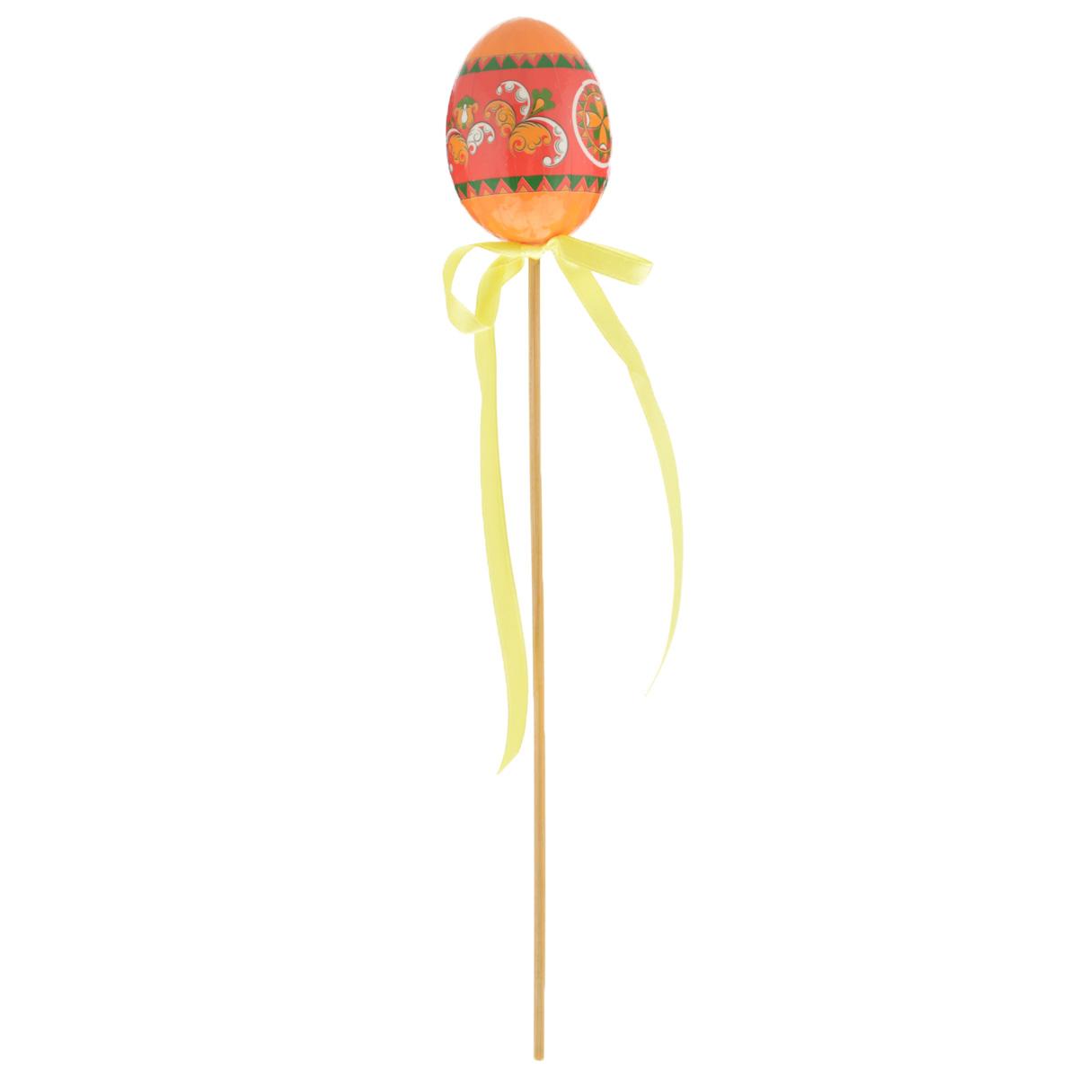 Декоративное пасхальное украшение на ножке Home Queen Народные промыслы, цвет: желтый, высота 26 см66754_1Украшение пасхальное Home Queen Народные промыслы изготовлено из высококачественного пластика и предназначено для украшения праздничного стола. Украшение выполнено в виде яйца на деревянной шпажке и украшено текстильным бантом. Такое украшение прекрасно дополнит подарок для друзей и близких на Пасху. Высота: 26 см. Размер фигурки: 4 см х 4 см х 6 см.