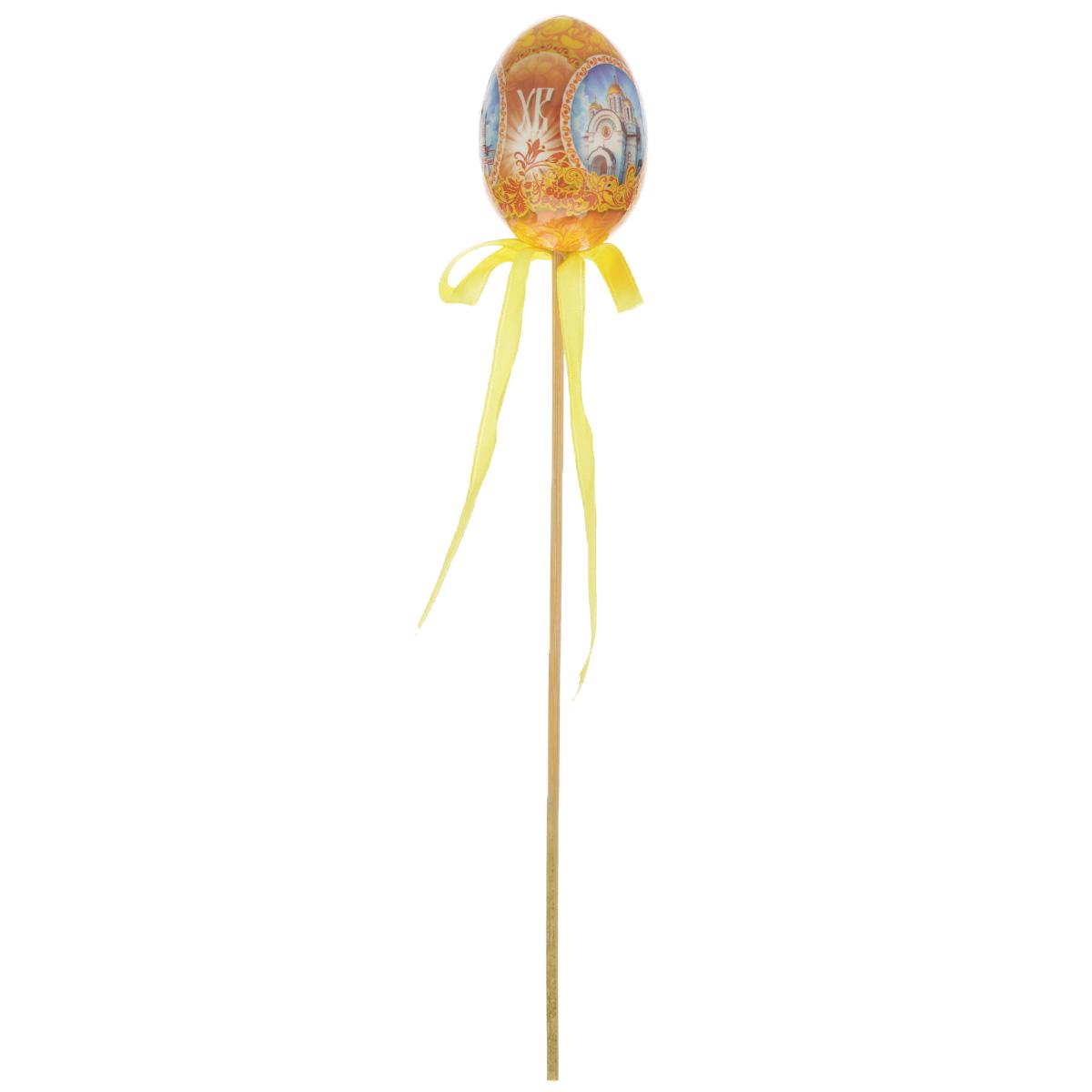 Декоративное украшение на ножке Home Queen Храмы, цвет: желтый, высота 26 см66756_1Декоративное украшение Home Queen Храмы выполнено из пластика в виде пасхального яйца на деревянной ножке, декорированного изображениями храмов. Изделие украшено текстильной лентой. Такое украшение прекрасно дополнит подарок для друзей или близких. Высота: 26 см. Размер яйца: 6,5 см х 4,5 см.