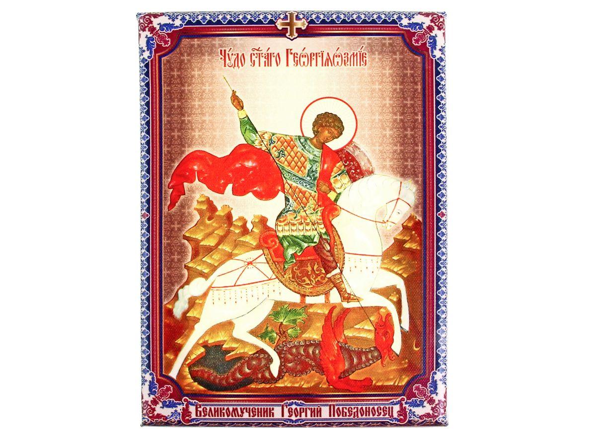 Икона Великомученик Георгий Победоносец, 14,5 см х 20,5 см156471Икона Великомученик Георгий Победоносец состоит из качественной деревянной рамки, обтянута холстом с полноцветным изображением. На обратной стороне имеется металлический подвес, благодаря чему икону удобно вешать на стену. Изображенный образ полностью соответствует канонам Русской Православной Церкви. Такая икона будет прекрасным подарком с духовной составляющей.