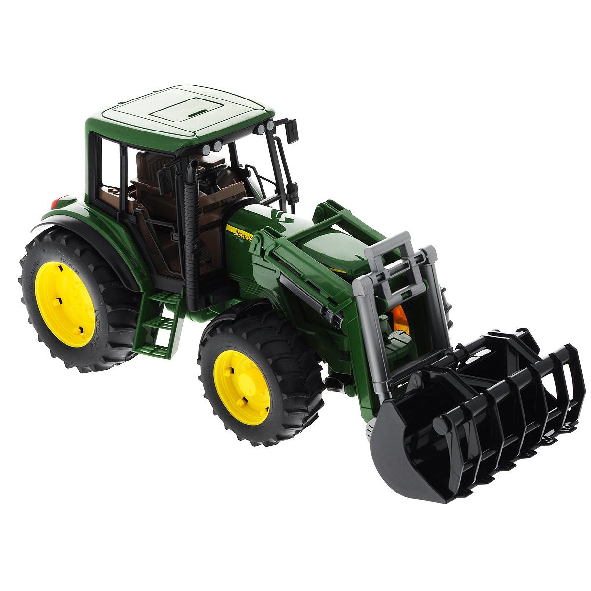 Bruder Трактор-погрузчик John Deere02-052Трактор Bruder John Deere, выполненный из прочного безопасного материала, отлично подойдет ребенку для различных игр. Машина является уменьшенной копией трактора фирмы John Deere. Трактор имеет съемный фронтальный погрузчик и может быть оснащен сдвоенными колесами. Управление происходит либо через кабину водителя с помощью руля, либо с помощью специального стержня, вставляющейся в люк на крыше водителя. Любой ребенок с легкостью справится с таким управлением. Капот трактора открывается, предоставляя доступ к двигателю. Трактор снабжен фаркопом; передняя ось оснащена амортизатором. В салон помещается небольшая фигурка или игрушка. Ковш трактора подвижен. Можно установить станок для колки бревен. Прорезиненные колеса с крупным протектором обеспечивают машине устойчивость и хорошую проходимость. Трактор совместим со всеми фигурками Bruder. Порадуйте своего ребенка таким замечательным подарком!