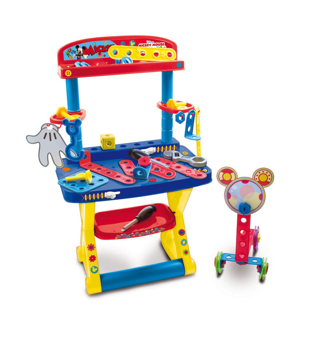 IMC Toys Игрушечный стол с инструментами Mickey Mouse181182Игрушечный стол с инструментами IMC Toys Mickey Mouse - это прекрасный подарок для детей, любящих помогать папе. Стол включает в себя различные детали - от инструментов, до элементов конструктора, с помощью которых ребенок самостоятельно сможет собрать множество увлекательных игрушек. В мастерской Mickey Mouse можно провести не один час. Здесь имеется все необходимое для ремонтных работ: удобная стойка, отвертки, ключи, гайки, планки и другие инструменты. Все детали удобно хранить на специальных полочках и крючках. Игрушка поможет ребенку стать самостоятельным и ответственным. Стол с инструментами развивает у ребенка внимательность, координацию движений, мелкую моторику рук, воображение, логическое мышление, зрительное восприятие, наблюдательность и терпение.