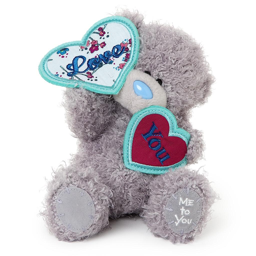 Me to You Мягкая игрушка Мишка Тедди, 13 см. G01W3454G01W3454Очаровательная игрушка Me to You Мишка Тедди выполнена в виде трогательного медвежонка. Забавная игрушка сделана из приятного и очень мягкого плюша, безвредного для малыша, а специальные гранулы, используемые при ее набивке, способствуют развитию мелкой моторики рук малыша. Глазки и носик выполнены из пластика. В лапках медвежонок держит трикотажные таблички, выполненные в форме сердца, с надписью Love You. Удивительно мягкая игрушка принесет радость и подарит своему обладателю мгновения нежных объятий и приятных воспоминаний. Долгая история Мишки Тедди создала целый культ в истории, про него снимали мультфильмы и фильмы, сочиняли сказки и песни, он был любимцем детей и взрослых множество лет и является им сейчас. Нет лучшего подарка для ребенка или для девушки, чем Мишка Тедди от Me To You. Он способен выразить Вашу любовь, заботу или дружбу. Он подарит огромное количество любви и ласки своему владельцу, как это делали миллионы других медведей Тедди, до...