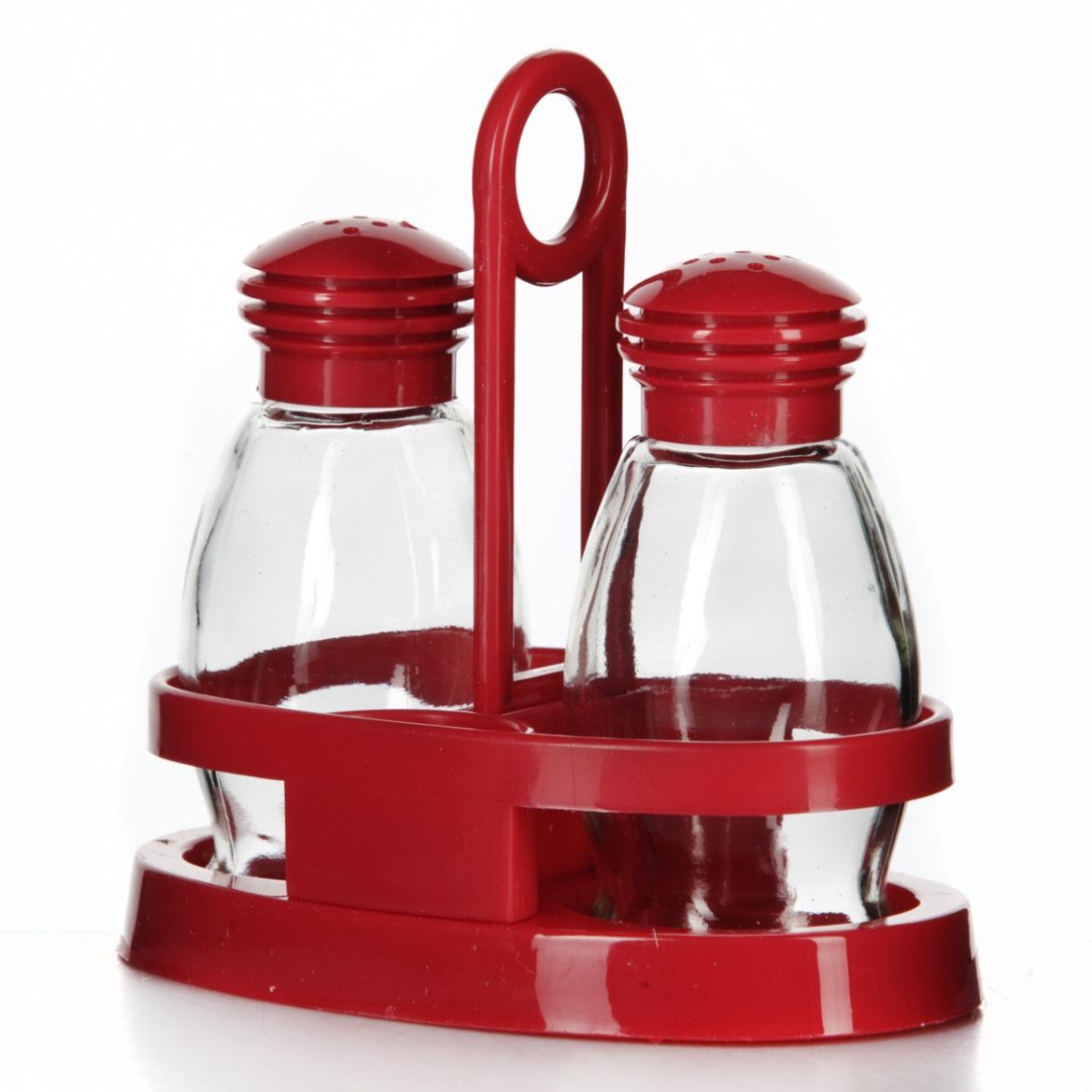 Набор для специй Herevin Mirage, цвет: красный, 3 предмета122020-000Набор для специй Herevin Mirage состоит из солонки, перечницы и подставки. Емкости выполнены из стекла, подставка и крышки изготовлены из пластика. Подставка оснащена двумя емкостями для зубочисток. Такой набор красиво и оригинально оформит ваш кухонный стол. Объем емкостей: 85 мл. Размер емкостей: 5 см х 5 см х 10,5 см. Размер подставки: 13,5 см х 8 см х 13,5 см.