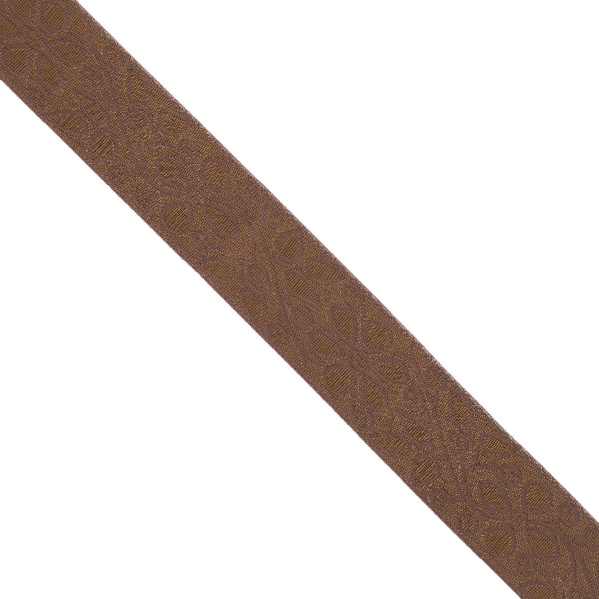 Тесьма декоративная Астра, цвет: коричневый (158/158D), ширина 3 см, длина 9 м. 77034497703449_158/158DДекоративная тесьма Астра выполнена из текстиля и оформлена оригинальным орнаментом. Такая тесьма идеально подойдет для оформления различных творческих работ таких, как скрапбукинг, аппликация, декор коробок и открыток и многое другое. Тесьма наивысшего качества и практична в использовании. Она станет незаменимым элементом в создании рукотворного шедевра. Ширина: 3 см. Длина: 9 м.