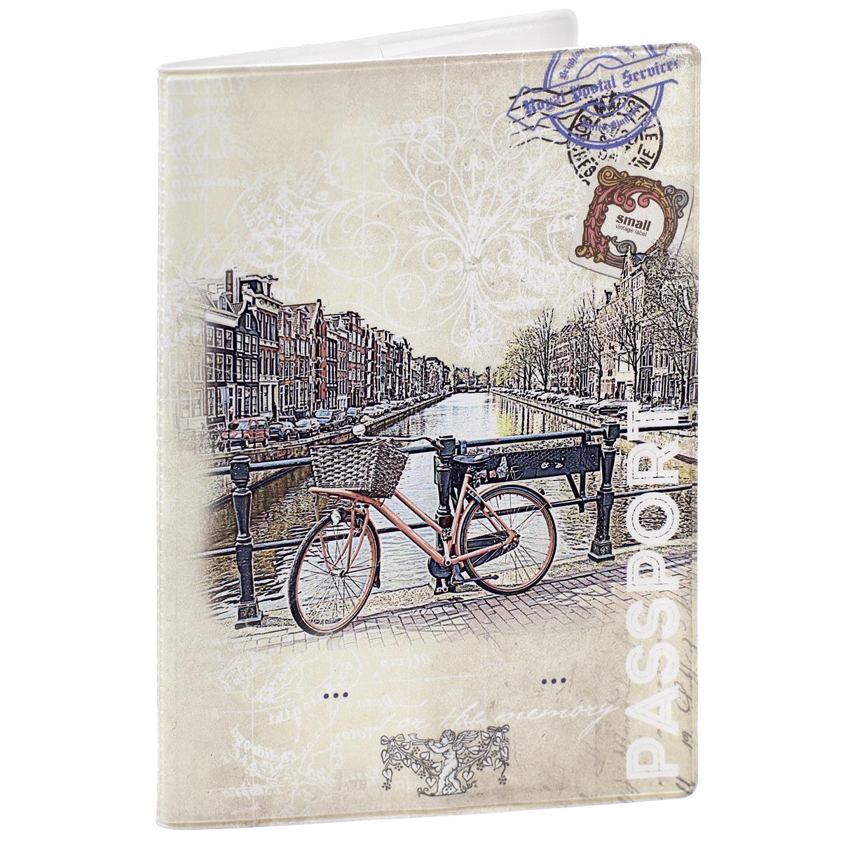 Обложка для паспорта Велосипед, цвет: бежевый. 3240132401Обложка для паспорта Велосипед не только поможет сохранить внешний вид ваших документов и защитить их от повреждений, но и станет стильным аксессуаром, идеально подходящим вашему образу. Обложка выполнена из поливинилхлорида и оформлена оригинальным изображением велосипеда, стоящего на набережной. Внутри имеет два вертикальных кармана из прозрачного пластика. Такая обложка поможет вам подчеркнуть свою индивидуальность и неповторимость!