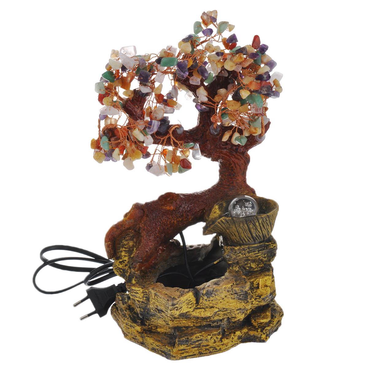 Фонтан Sima-land Колодец счастья420261Фонтан Sima-land Колодец счастья, изготовленный из полистоуна, украсит интерьер любого помещения. Изделие выполнено в виде дерева бонсай, растущего у колодца. Листья дерева выполнены в виде разноцветных декоративных камней. На источнике помещается стеклянный шар, который подсвечивается светодиодами и левитирует над водой при включении фонтана. Журчание и вид воды, стекающей струями из миниатюрного фонтана и искрящейся на солнце, могут изменить облик вашего дома и сада, создавая атмосферу покоя. Фонтан работает при помощи электрического погружного центробежного насоса, входящего в комплект. Интерьерный фонтан хорошо увлажняет воздух, благотворно воздействуя на наш организм и создавая здоровый климат. Размер фонтана: 16 см х 12,5 см х 32 см. Длина провода: 150 см. УВАЖАЕМЫЕ КЛИЕНТЫ! Обращаем ваше внимание на то, что фонтан работает от сети 220V.