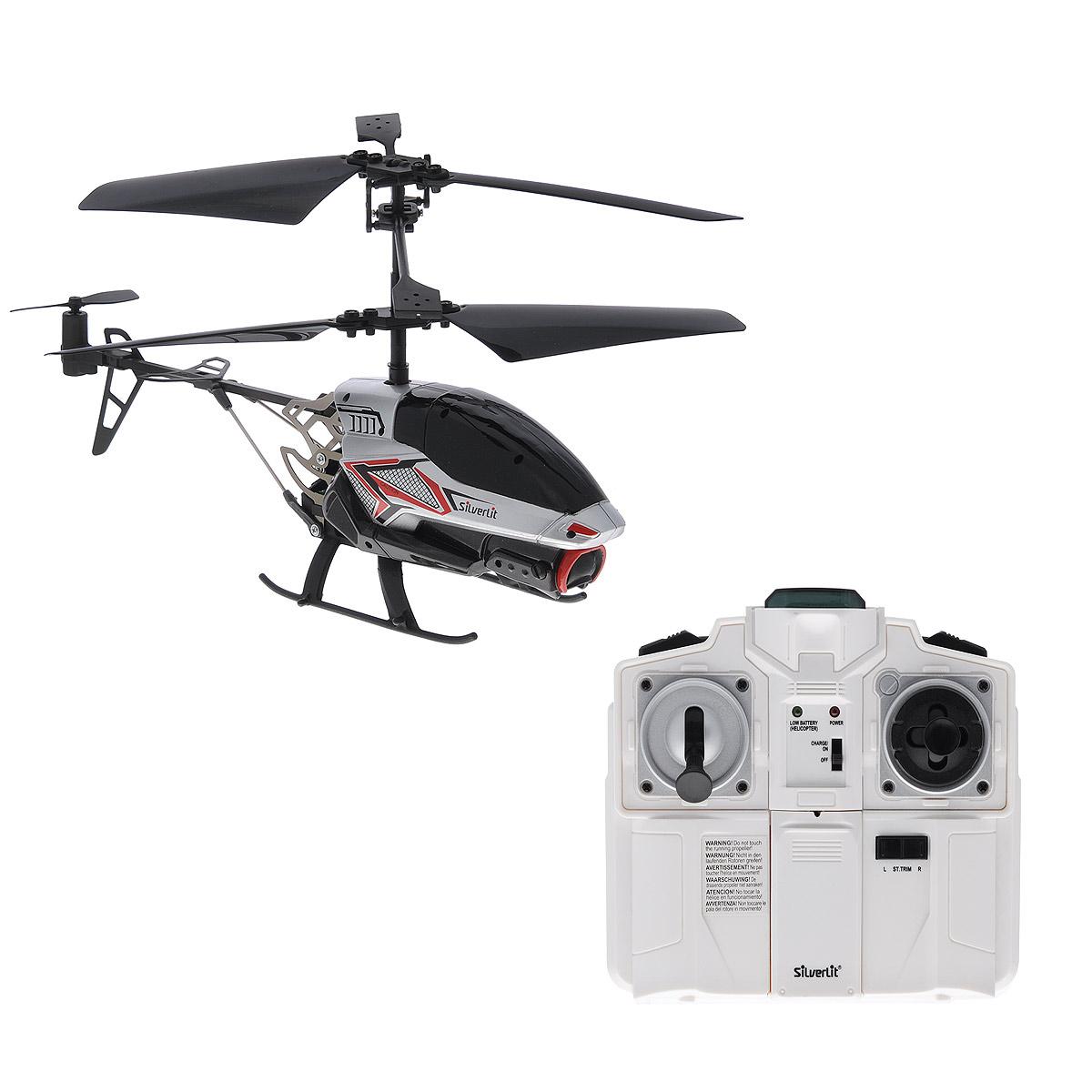Silverlit Вертолет на радиоуправлении Spy Cam II цвет темно-серый серебристый84601_серРадиоуправляемая модель Silverlit Вертолет Spy Cam II привлечет внимание не только ребенка, но и взрослого, и станет отличным подарком любителю воздушной техники. Вертолет оснащен встроенным гироскопом, который помогает скорректировать и устранить нежелательные вращения корпуса вертолета. Благодаря гироскопу сохраняется высокая устойчивость полета, что позволяет полностью контролировать его процесс, управляя без суеты и страха сломать игрушку. Каркас вертолета выполнен из пластика с использованием металла. Вертолет имеет трехканальное дистанционное управление, с помощью пульта управления можно менять скорость полета, а также проделывать фигуры высшего пилотажа. Модель вертолета идеально подходит для игры как внутри помещения, так и на улице. Вертолет оснащен функцией фото и видеосъемки, позволяющей отснять видео длительностью 3 минуты или сделать 100 фотографий. Есть разъем под microSD-карту. Зарядка аккумулятора осуществляется от USB-провода или пульта...