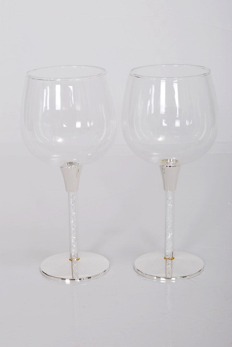 Набор бокалов Marquis Хрусталики, 380 мл, 2 шт. 1099-MR1099-MRНабор Marquis Хрусталики, выполненный из высококачественного стекла и стали с никель-серебряным покрытием, состоит из двух бокалов на ножке. Бокалы предназначены для подачи холодных напитков. Их оценят как любители классики, так и те, кто предпочитает современный дизайн. Набор идеально подойдет для сервировки стола и станет отличным подарком к любому празднику. Диаметр бокала по верхнему краю: 7 см. Высота: 18 см.