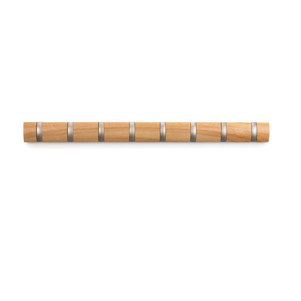 Вешалка настенная Umbra Flip, цвет: бежевый, 8 крючков318858-390Стильная и прочная вешалка Umbra Flip интересной формы и оригинального дизайна изготовлена из дерева. Имеет 8 откидных крючков из никеля: когда они не используются, то складываются, превращая конструкцию в абсолютно гладкую поверхность. Вешалка Umbra Flip идеально подходит для маленьких прихожих и ограниченных пространств. Каждый крючок выдерживает вес до 2,3 кг. Размер вешалки: 82 см х 6 см х 3 см.