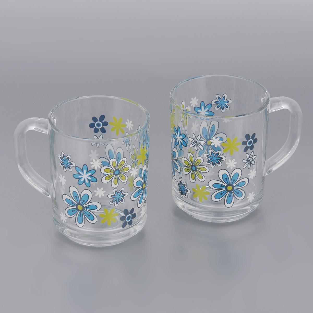 Набор кружек Pasabahce Workshop Голубые цветы, 250 мл, 2 шт55029B/D5Набор Pasabahce Workshop Голубые цветы состоит из двух кружек с удобными ручками, выполненных из прочного натрий-кальций-силикатного стекла. Кружки декорированы ярким изображением цветов. Изделия хорошо удерживают тепло, не нагреваются. На них не выгорает и не вымывается рисунок. Посуда Pasabahce Workshop будет радовать вас яркими, интересными рисунками и качеством изготовления. Не рекомендуется мыть в посудомоечных машинах и использовать в микроволновых печах. Диаметр кружки по верхнему краю: 7 см. Высота кружки: 8,5 см.