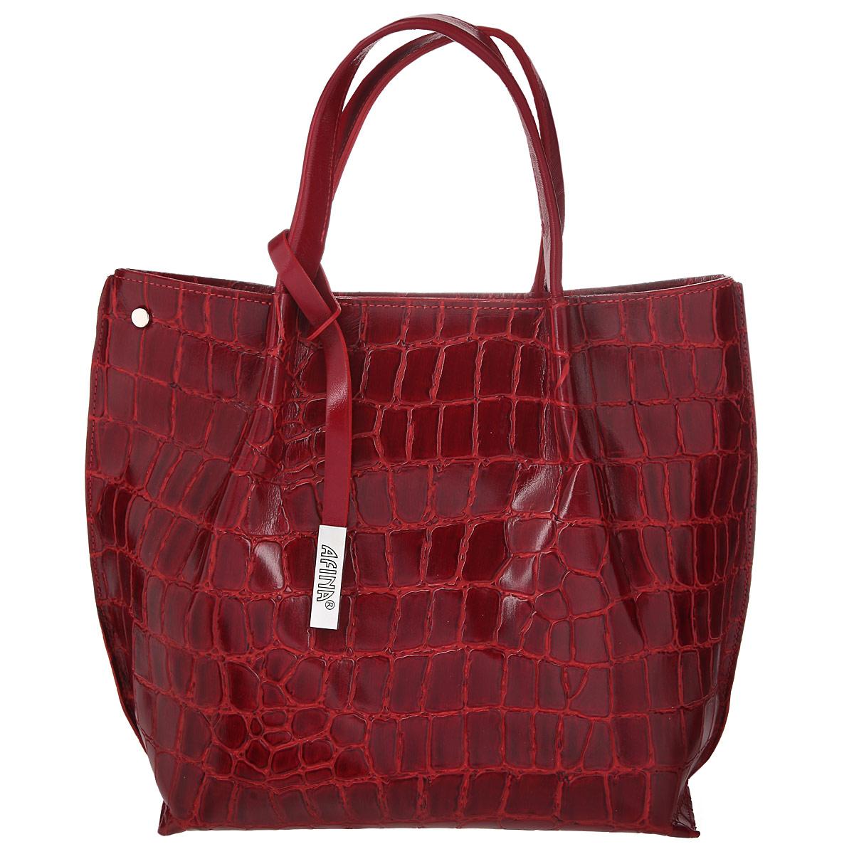 Сумка женская Afina, цвет: красный. 865865Изысканная женская сумка Афина выполнена из натуральной качественной кожи. Сумка закрывается на пластиковую застежку-молнию. Внутри - большое отделение, разделенное средником на застежке-молнии, небольшой втачной кармашек на застежке-молнии и два накладных кармашка для телефона, мелочей. На задней стенке - втачной карман на застежке-молнии. В комплекте съемный плечевой ремень регулируемой длины. Роскошная сумка внесет элегантные нотки в ваш образ и подчеркнет ваше отменное чувство стиля.