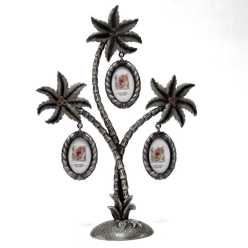 Металлическая фоторамка Пальма, на 3 фотографий. 9471894718Оригинальная рамка для фотографий выполнена в виде пальмы, на ветвях которого прикреплены небольшие рамочки овальной формы. На такой пальме вы сможете разместить фото всей своей семьи. Рамка выполнена из металла серебристого цвета и украшена декоративной эмалью и стразами.Такая рамка послужит оригинальным и практичным подарком. Характеристики: Материал: металл, пластик. Размер пальмы (ДхШхВ): 24,5 см х 5 см х 18 см. Размер фоторамки: 5 см х 4 см. Размер фото: 2,5 см х 4 см. Цвет: серебристый. Артикул: 91748. Производитель: Китай.