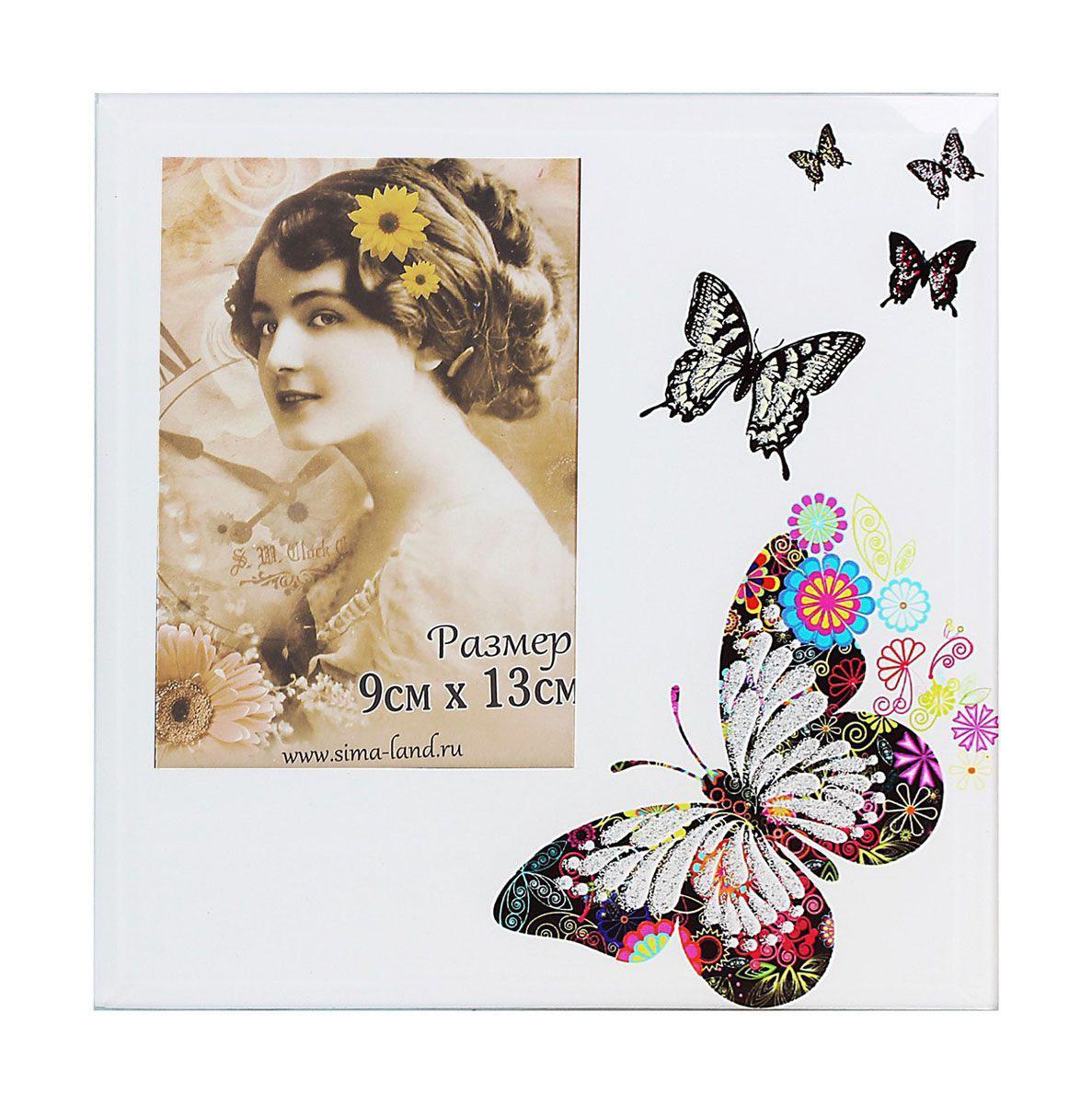 Фоторамка Sima-land Шарм бабочек, цвет: голубой, 9 см х 13 см503986Декоративная фоторамка Sima-land Шарм бабочек выполнена из стекла и декорирована изображениями бабочек. Обратная сторона рамки оснащена специальной ножкой, благодаря которой ее можно поставить на стол или любое другое место в доме или офисе. Такая фоторамка украсит ваш интерьер оригинальным образом, а также позволит сохранить память о дорогих вам людях и интересных событиях вашей жизни. С ней вы сможете не просто внести в интерьер своего дома элемент оригинальности, но и создать атмосферу загадочности и изысканности.