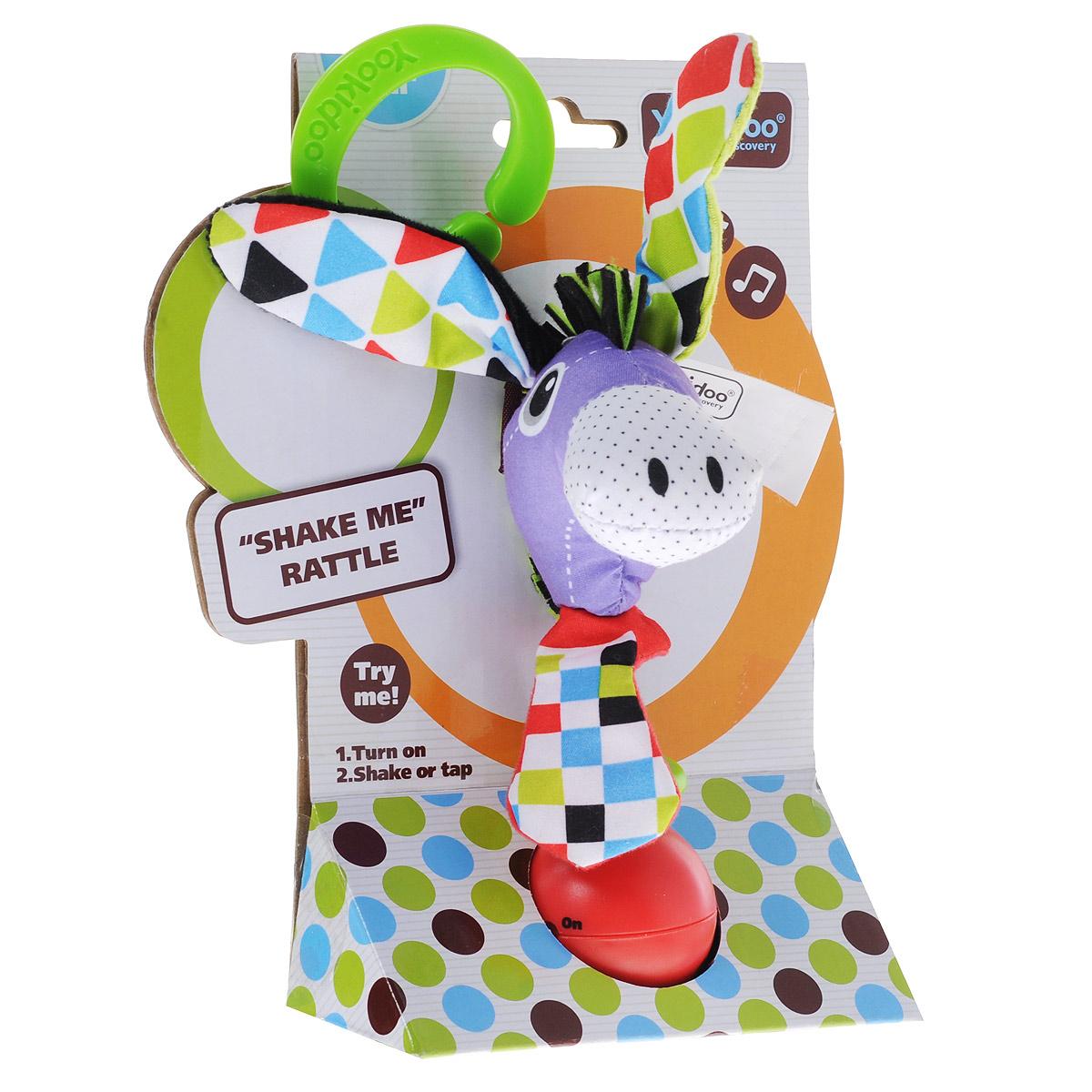 Развивающая игрушка-погремушка Yookidoo Ослик40135Мягкая развивающая игрушка-погремушка Ослик выполнена из текстильного материала различных цветов и фактур в виде симпатичного ослика с галстуком. Голова ослика крепится на подставку, на которую нанизаны три разноцветных колечка. Ушки ослика и галстук оснащены шуршащими элементами. Играть с такой погремушкой сплошное удовольствие! Если встряхнуть ослика, он начинает воспроизводить различные звуковые эффекты. В комплект входит пластиковое кольцо, благодаря которому игрушку легко можно прикрепить к кроватке, коляске, автокреслу или развивающему коврику. Игрушка работает от 3-х батареек 1,5 V типа AG 13 (входят в комплект). Игрушка-погремушка Ослик поможет ребенку в развитии цветового и звукового восприятия, концентрации внимания, мелкой моторики рук, координации движений и тактильных ощущений, улучшит хватательные навыки малыша, а также подарит отличное настроение.